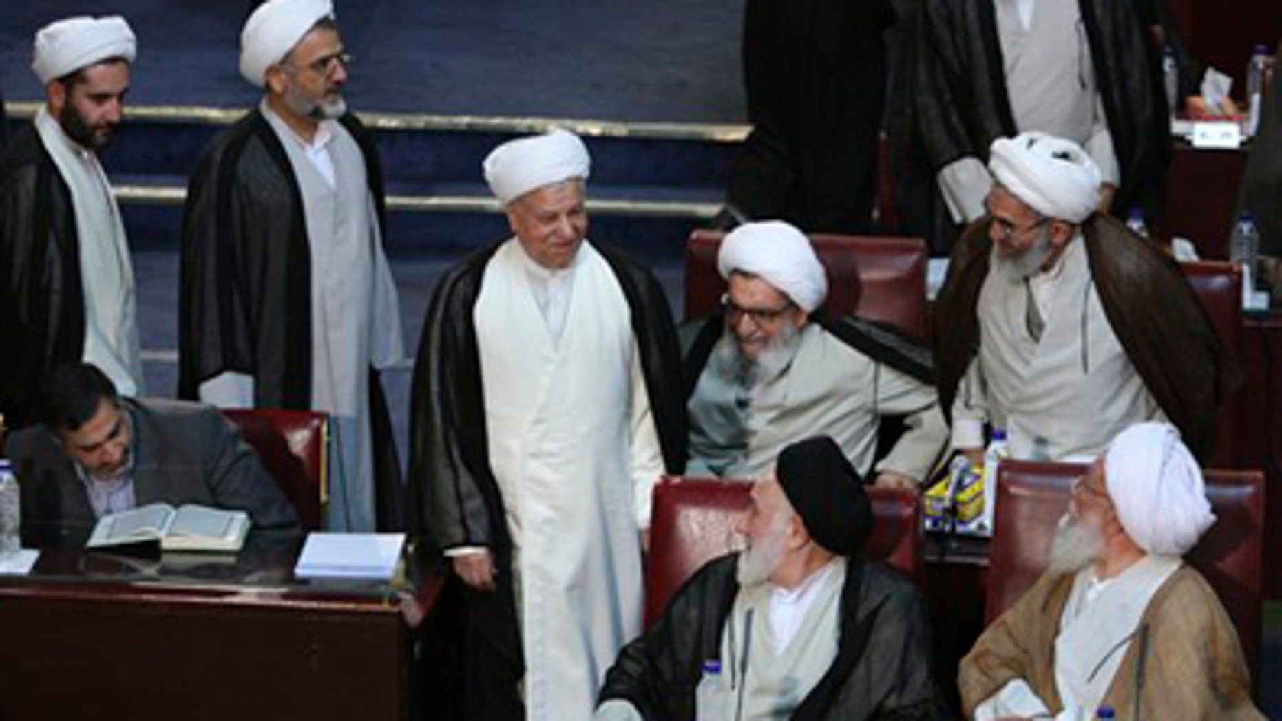 Tuesday: Former influential President Akbar Hashemi Rafsanjani, center, a member of Iran's Experts Assembly, arrives to attend the assembly's seasonal meeting, in Tehran, Iran.  The Experts Assembly is a powerful clerical body with the right to monitor the performance of Iran's supreme leader.