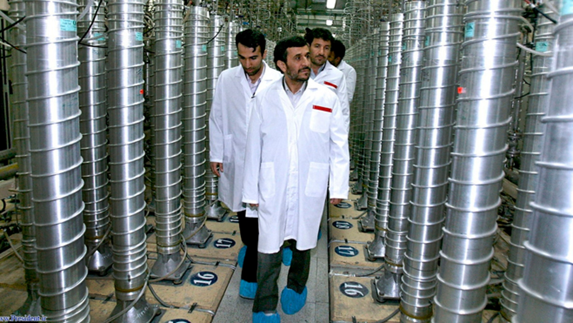 In this April 8, 2008 file photo released by the Iranian President's Office, Iranian President Mahmoud Ahmadinejad, front center, visits the Natanz Uranium Enrichment Facility some 200 miles south of the capital Tehran, Iran.  Technicians upgrading Irans main uranium enrichment facility have tripled partial or full installations of high-tech machines that could be used in a nuclear weapons program to more than 600 since starting their work three months ago, according to diplomats who demanded anonymity because they said they are not authorized to disclose the information, Wednesday April 17, 2013.