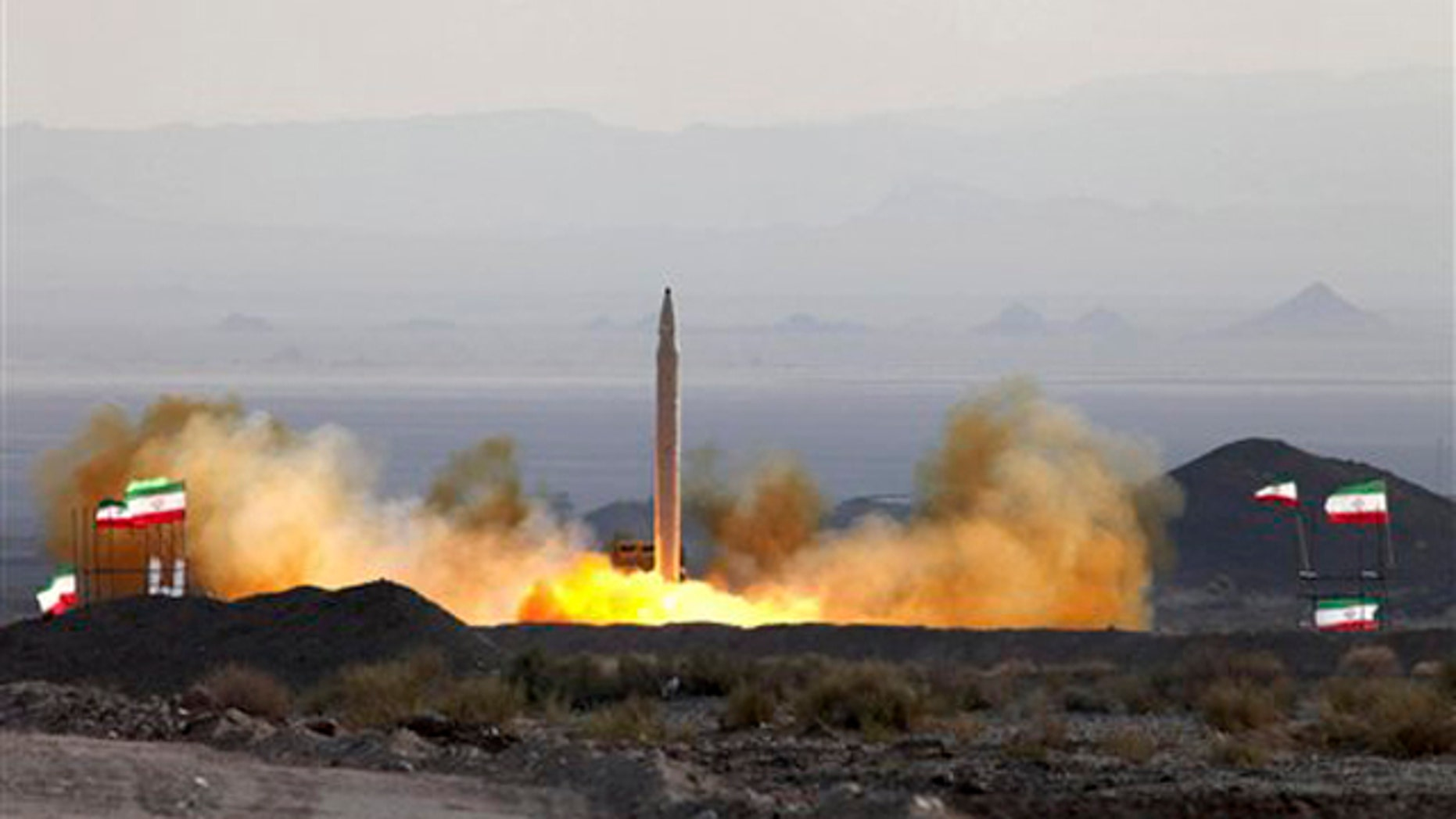This Aug. 20 photo, by the Iranian Defense Ministry, claims to show the launch of the Qiam-1 liquid-fueled missile by Iranian armed forces, at an undisclosed location. It is an example of Iran's potential retaliatory power. (AP Photo)