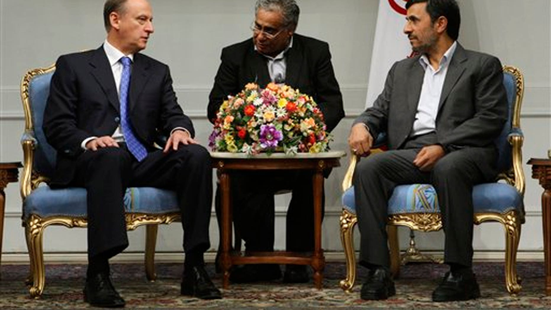 Aug. 16: Iranian President Mahmoud Ahmadinejad, right, meets with Russia's Security Council Secretary Nikolai Patrushev at the presidency office in Tehran, Iran. Iran's state news agency said Patrushev arrived Monday in Tehran to discuss a proposal to bring Iran back to negotiations over its disputed nuclear program.