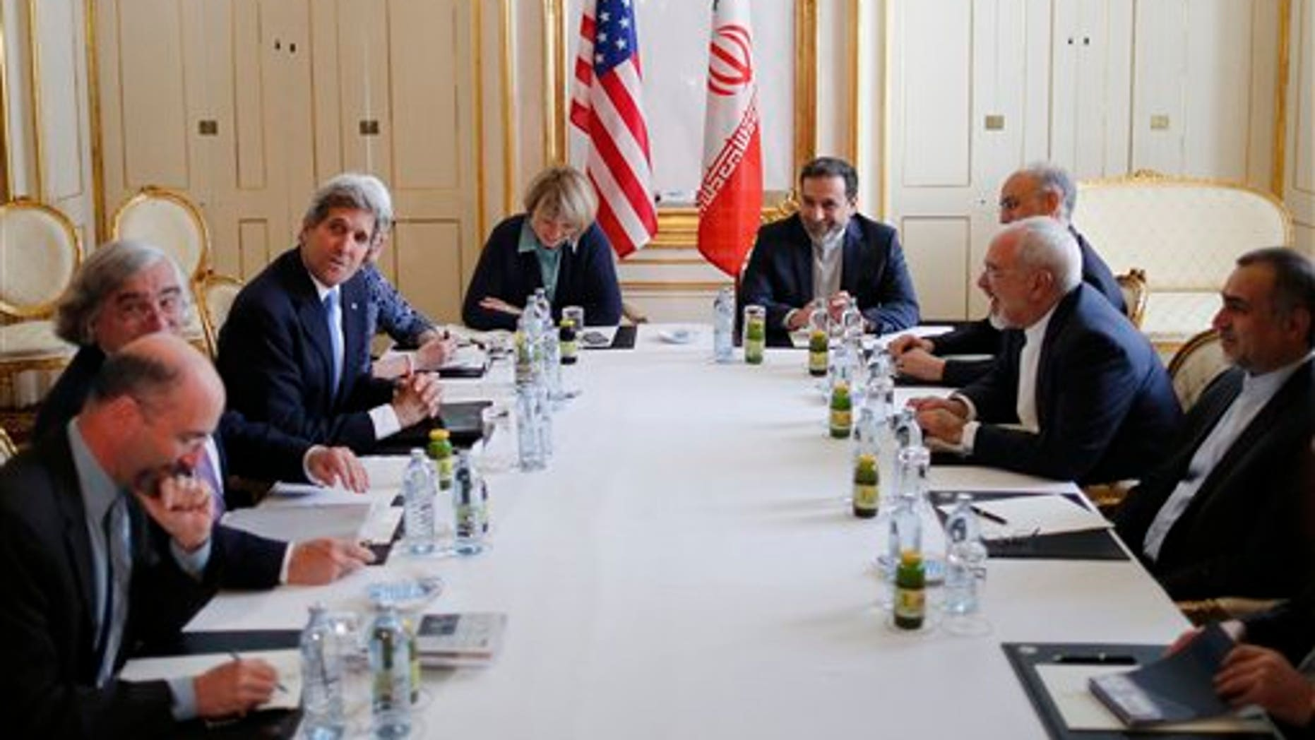 U.S. Secretary of State John Kerry, 3rd left, meets with Iranian Foreign Minister Javad Zarif, 2nd right, at an hotel in Vienna, Wednesday July 1, 2015. The head of the U.N. agency tasked to monitor a nuclear deal is traveling to Tehran to meet with Iranian President Hassan Rouhani, the agency said Wednesday. (Carlos Barria/Pool Photo via AP)
