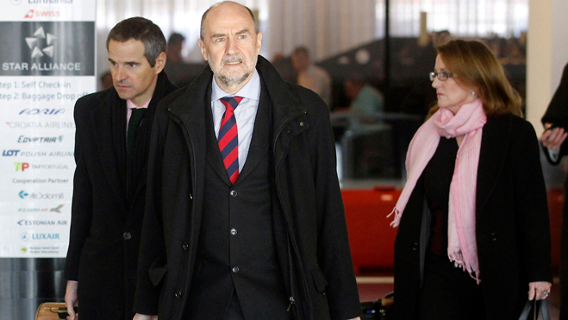 Jan. 15, 2013: Herman Nackaerts, center, of the International Atomic Energy Agency, IAEA, Deputy Director General and Head of the Department of Safeguards, arrives for his flight to Iran at Vienna's Schwechat airport, Austria.