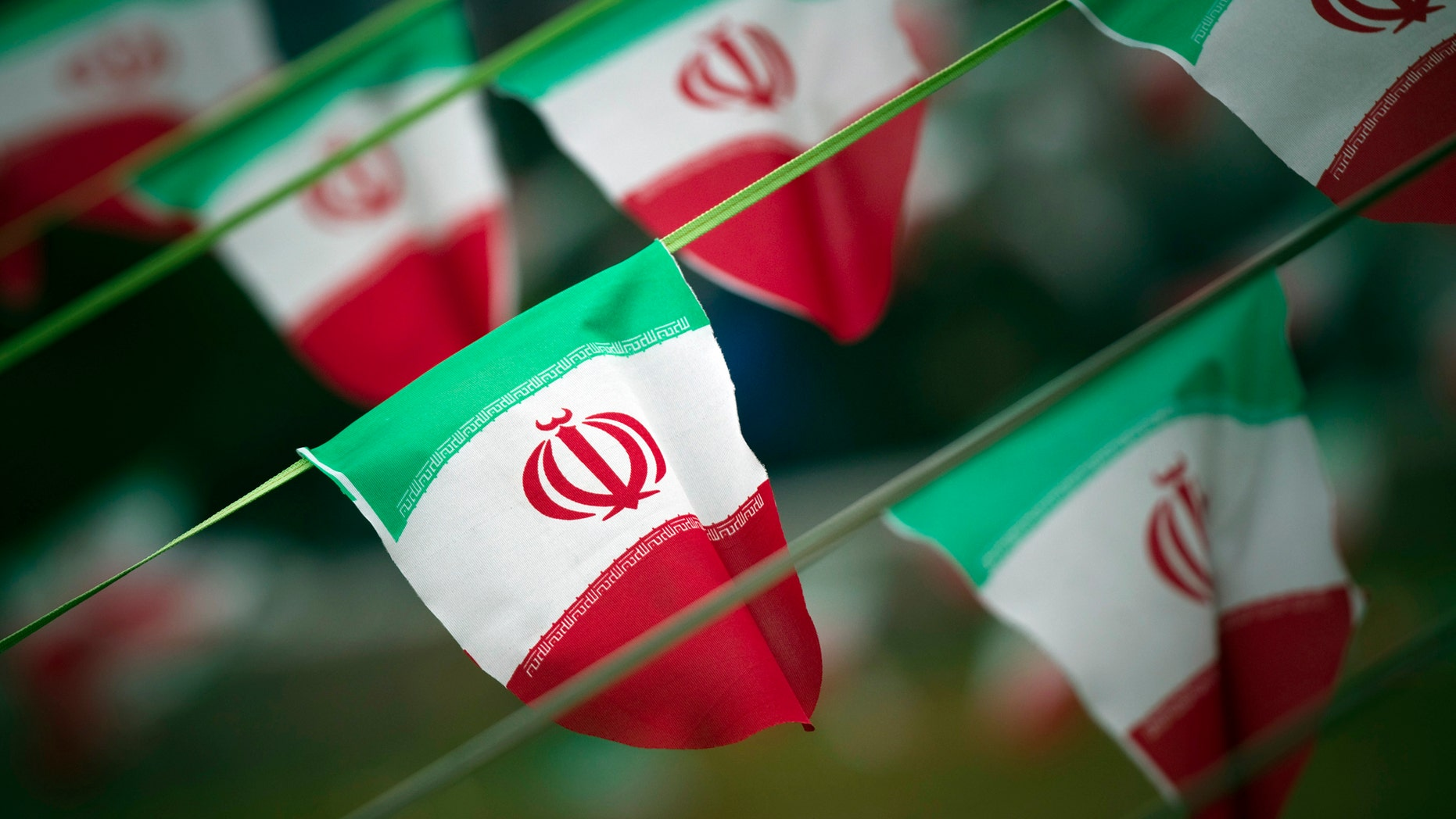 File photo - Iran's national flags are seen on a square in Tehran February 10, 2012, a day before the anniversary of the Islamic Revolution. (REUTERS/Morteza Nikoubazl)