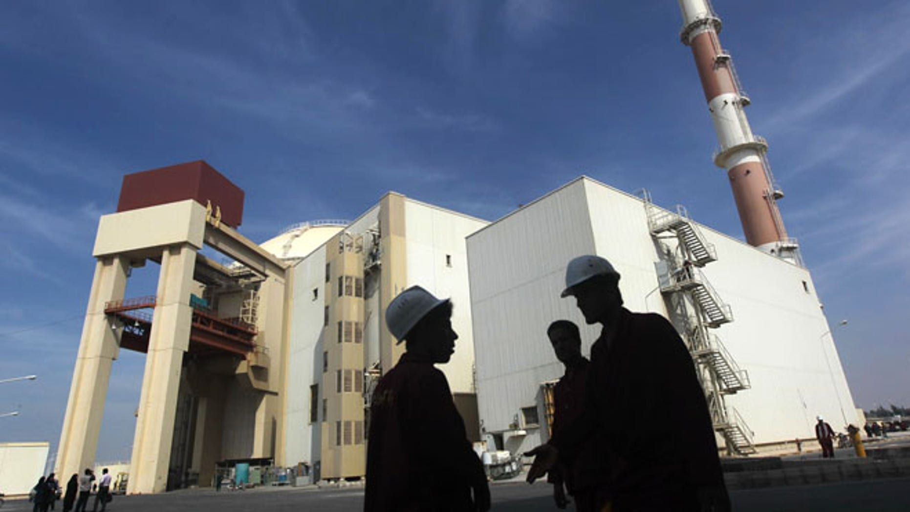 Oct. 26, 2010: Iranian workers stand in front of the Bushehr nuclear power plant, about 1,200 km  south of Tehran. (Reuters)