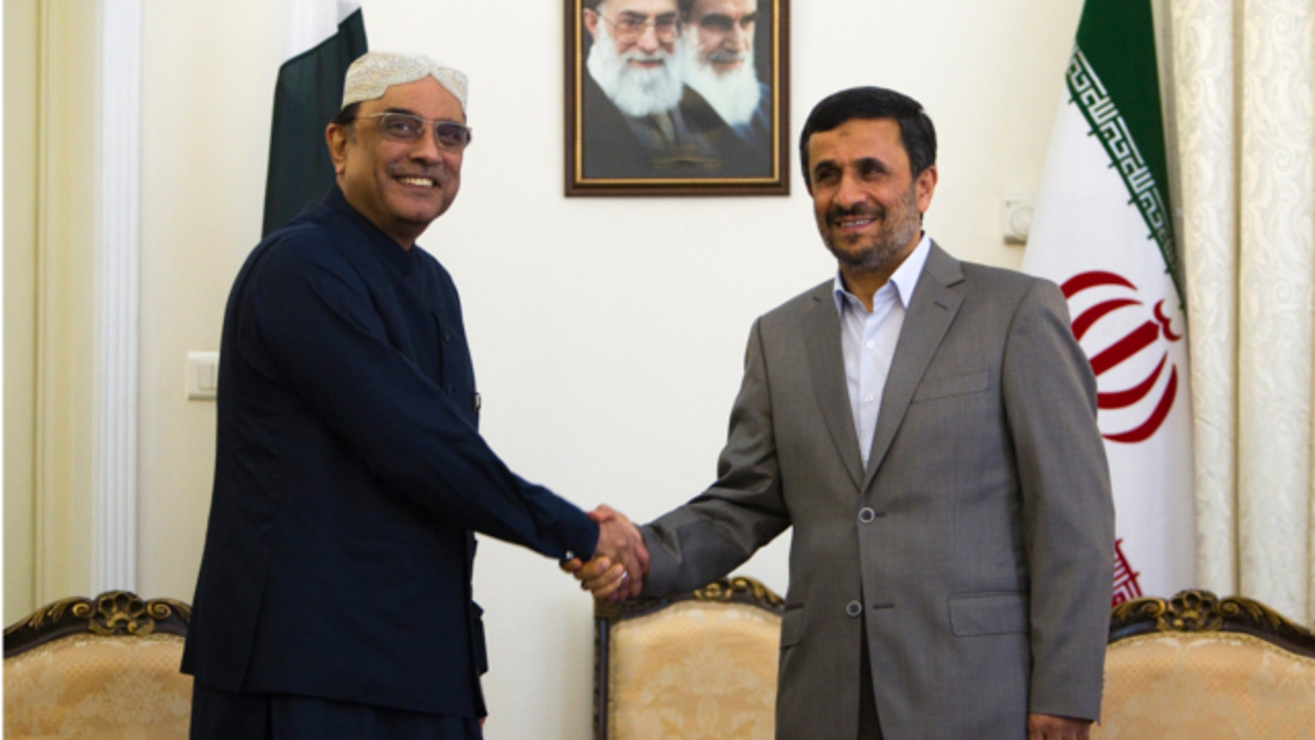 July 16, 2011: Iran's President Mahmoud Ahmadinejad (R) shakes hands with his Pakistani counterpart Asif Ali Zardari during a meeting in Tehran