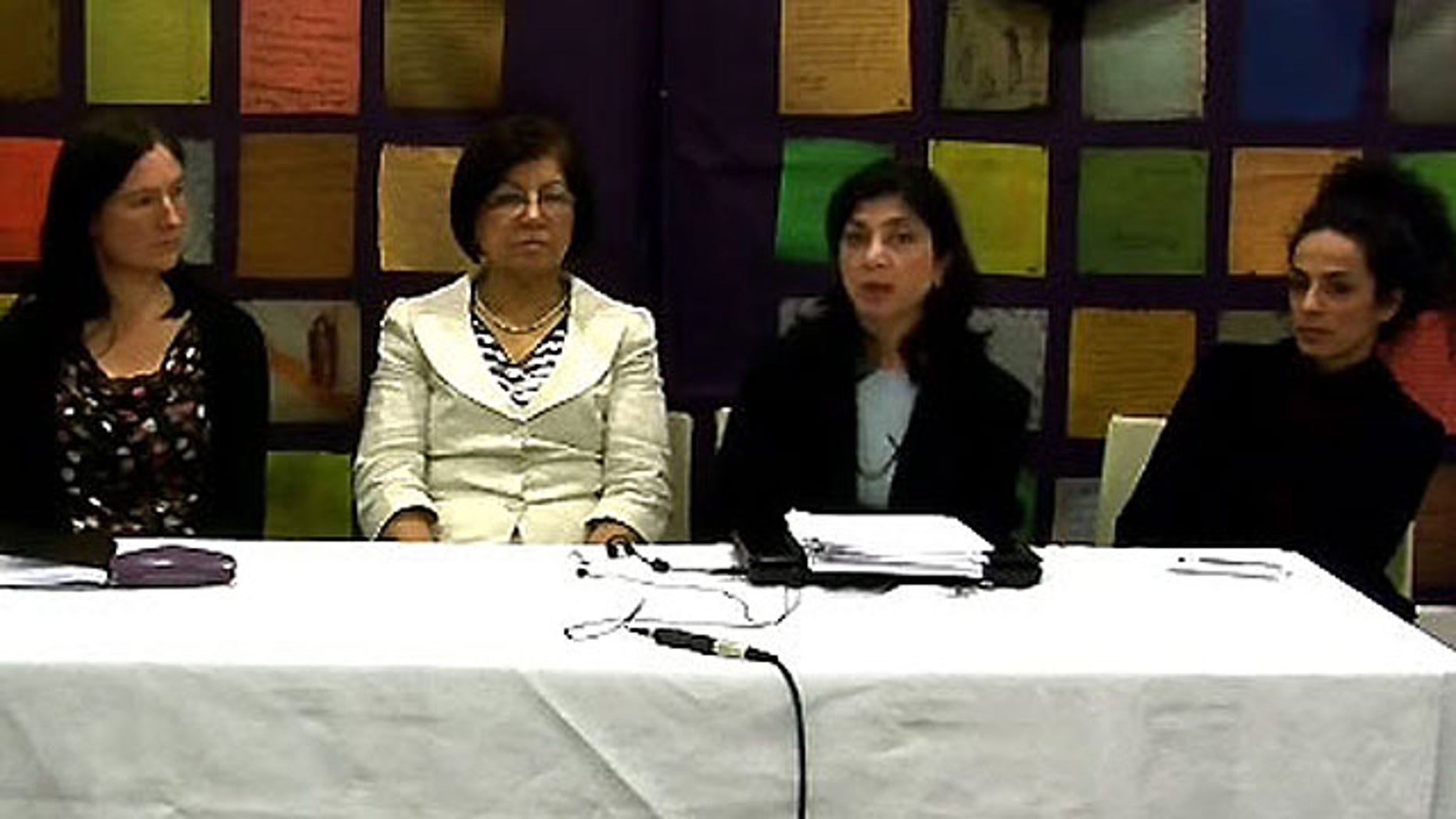 Panelists at last week's press conference discuss Iran's Family Protection Bill. From left: Ann Harrison, Amnesty International; Rouhi Shafii, International Coalition Against Violence in Iran; Roya Kashefi, Association des Chercheurs Iraniens; and journalist Masih Alinejad.