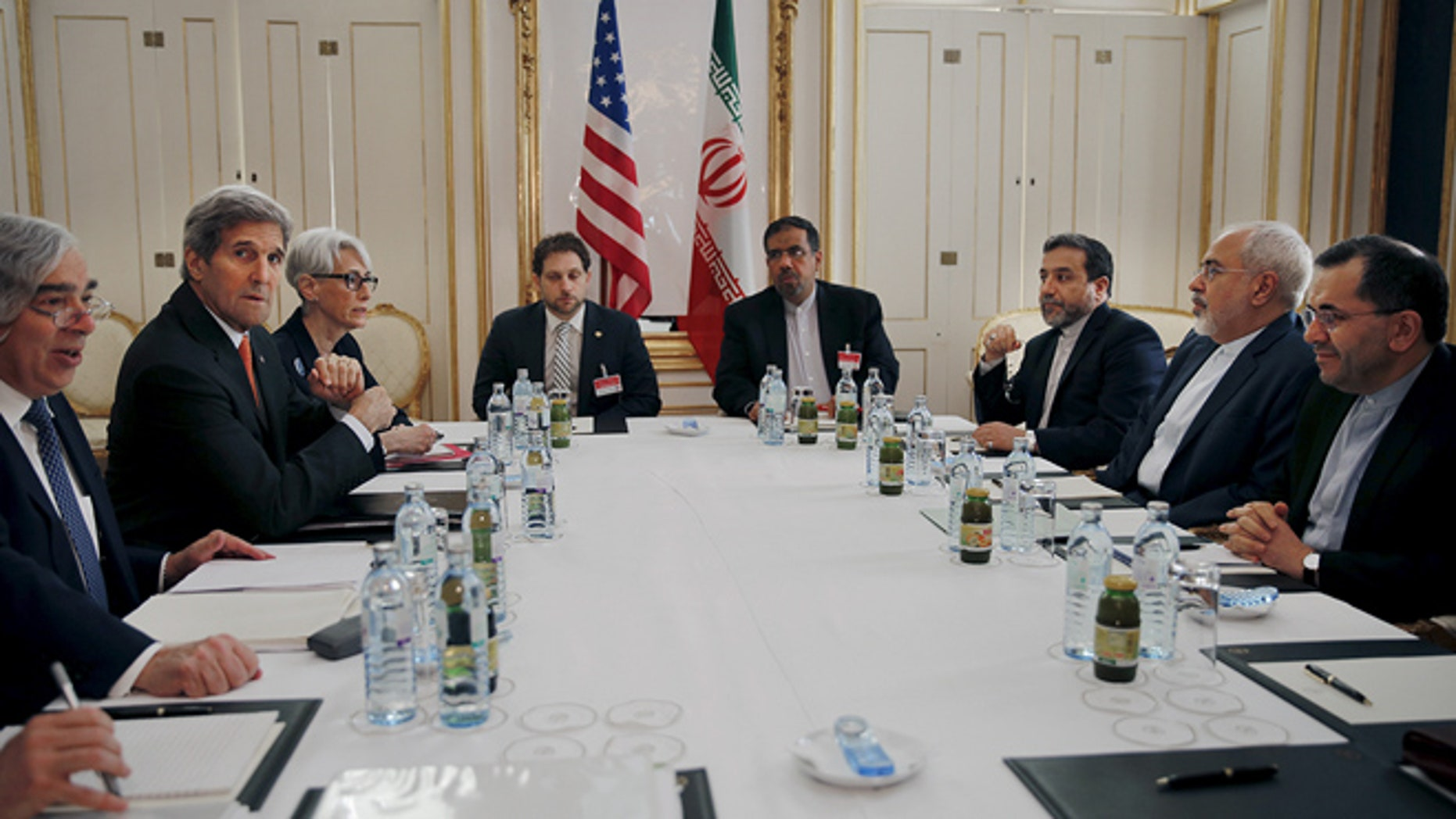 U.S. Secretary of Energy Ernest Moniz, U.S. Secretary of State John Kerry and U.S. Under Secretary for Political Affairs Wendy Sherman (L-3rd L) meet with Iranian Foreign Minister Mohammad Javad Zarif (2nd R) at a hotel in Vienna, Austria June 28, 2015.