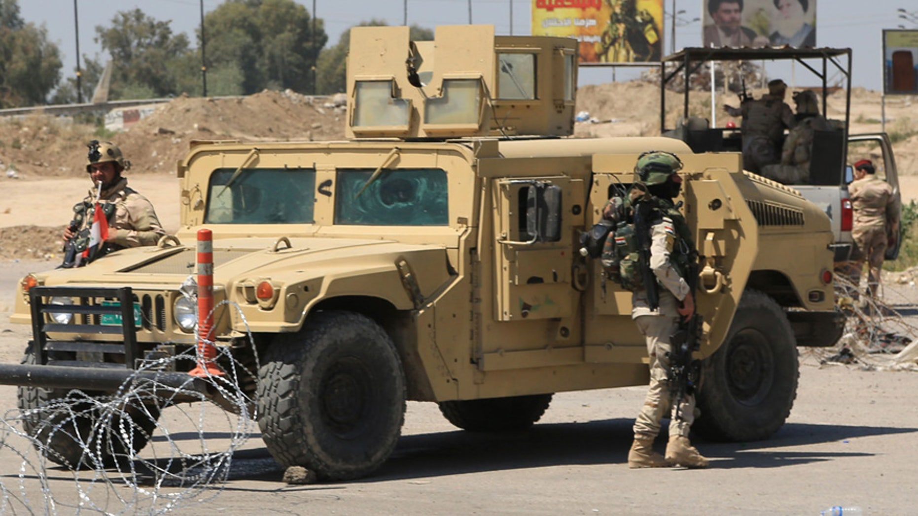 April 4, 2016: Iraqi army stand guard at the site near of a suicide attack targeting a checkpoint in Baghdad Iraq.
