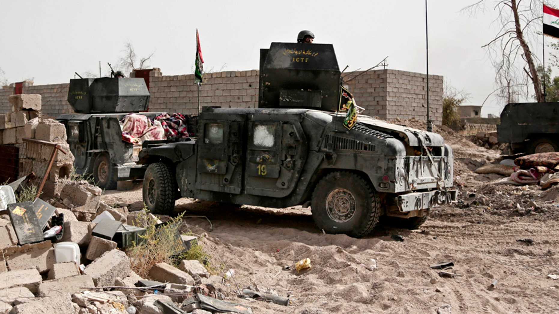 June 8, 2016: Humvees stage on the the edge of the Shuhada neighborhood in Islamic State-held Fallujah, Iraq, just before Iraqi special forces pushed into the district.