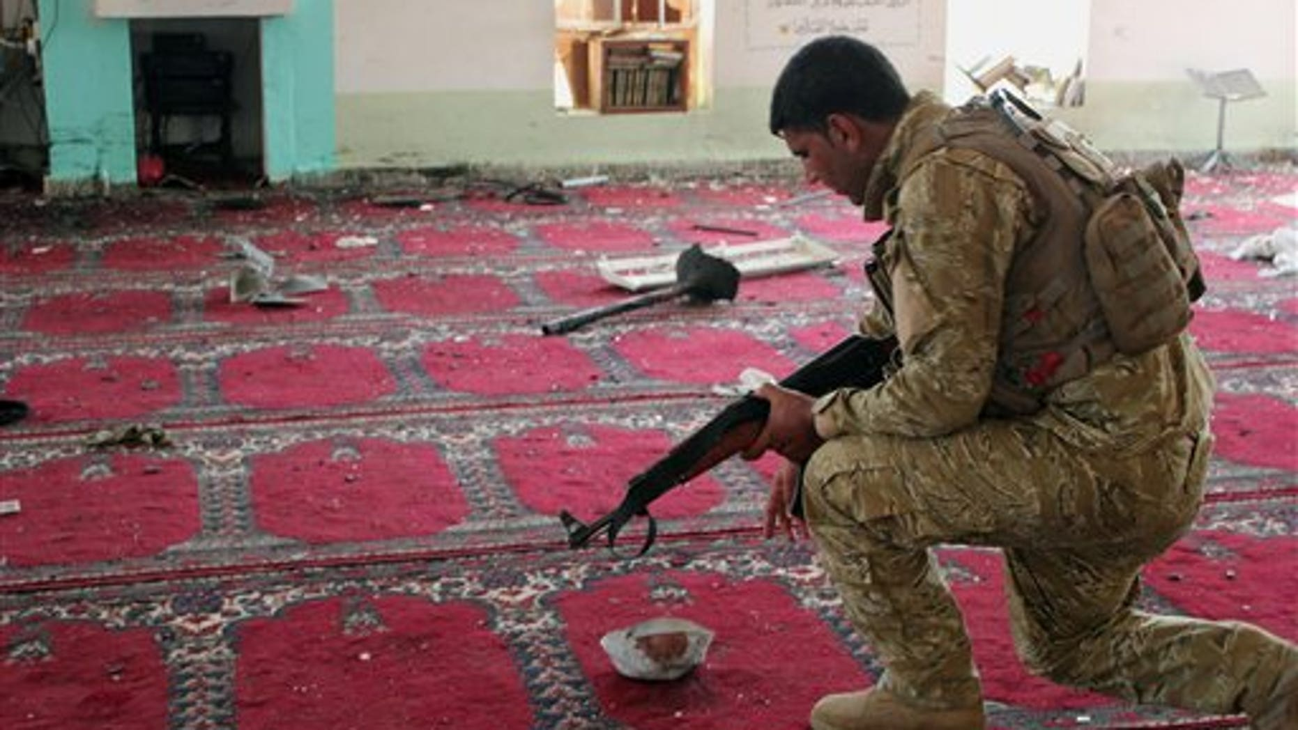 July 19, 2013 - An Iraqi army soldier inspects the damage inside the Abu Bakr Mosque in Baqouba, northeast of Baghdad, Iraq. A bomb hidden in an air conditioner that ripped through a Sunni mosque during midday prayers and other attacks killed dozens in Iraq on Friday, extending a wave of violence targeting worshippers during the holy month of Ramadan.