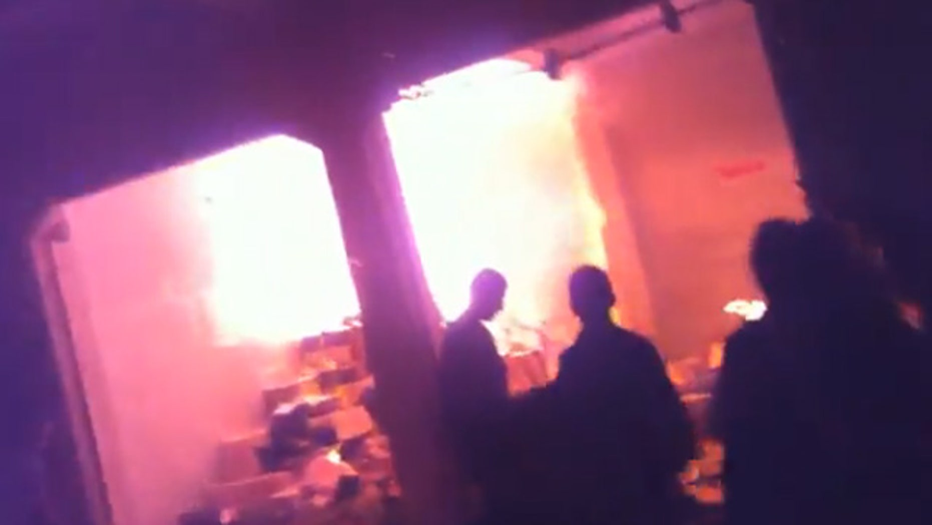 The image shown here, taken from a video posted online, is purported to show attacks on businesses in northern Iraq following a sermon Dec. 2. The authenticity of the video could not be verified.