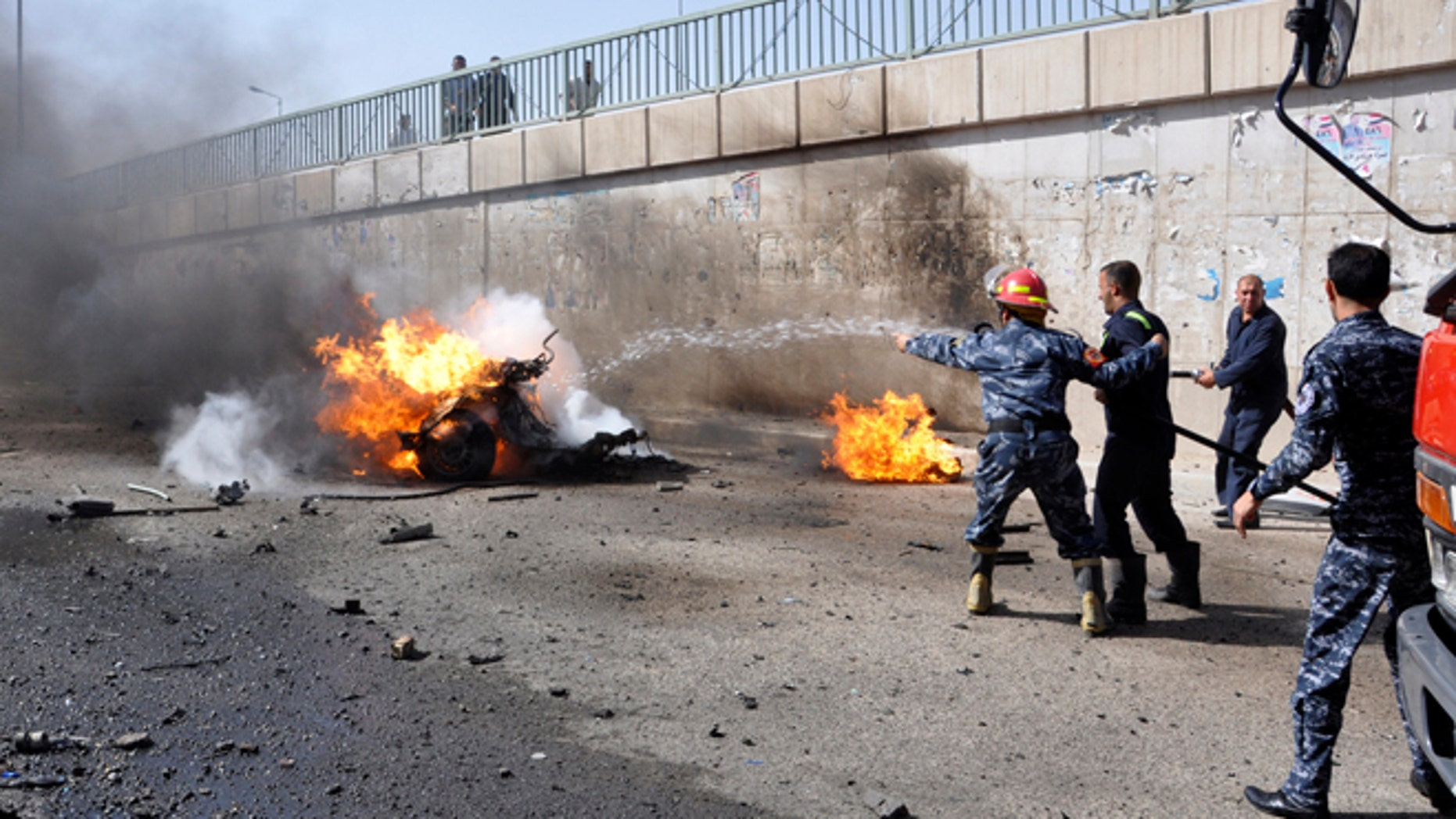 June 16, 2013: Firemen try to put out a burning vehicle after a car bomb attack, where police reported two dead and 19 injured, in Nasiriyah city, 233 miles south of Baghdad. At least 20 people were killed in car bombings and shootings across Iraq on Sunday, police and medics said. The car bombs were mainly in provinces with a high concentration of Shiite Muslims and one shooting took place in the northern city of Mosul.