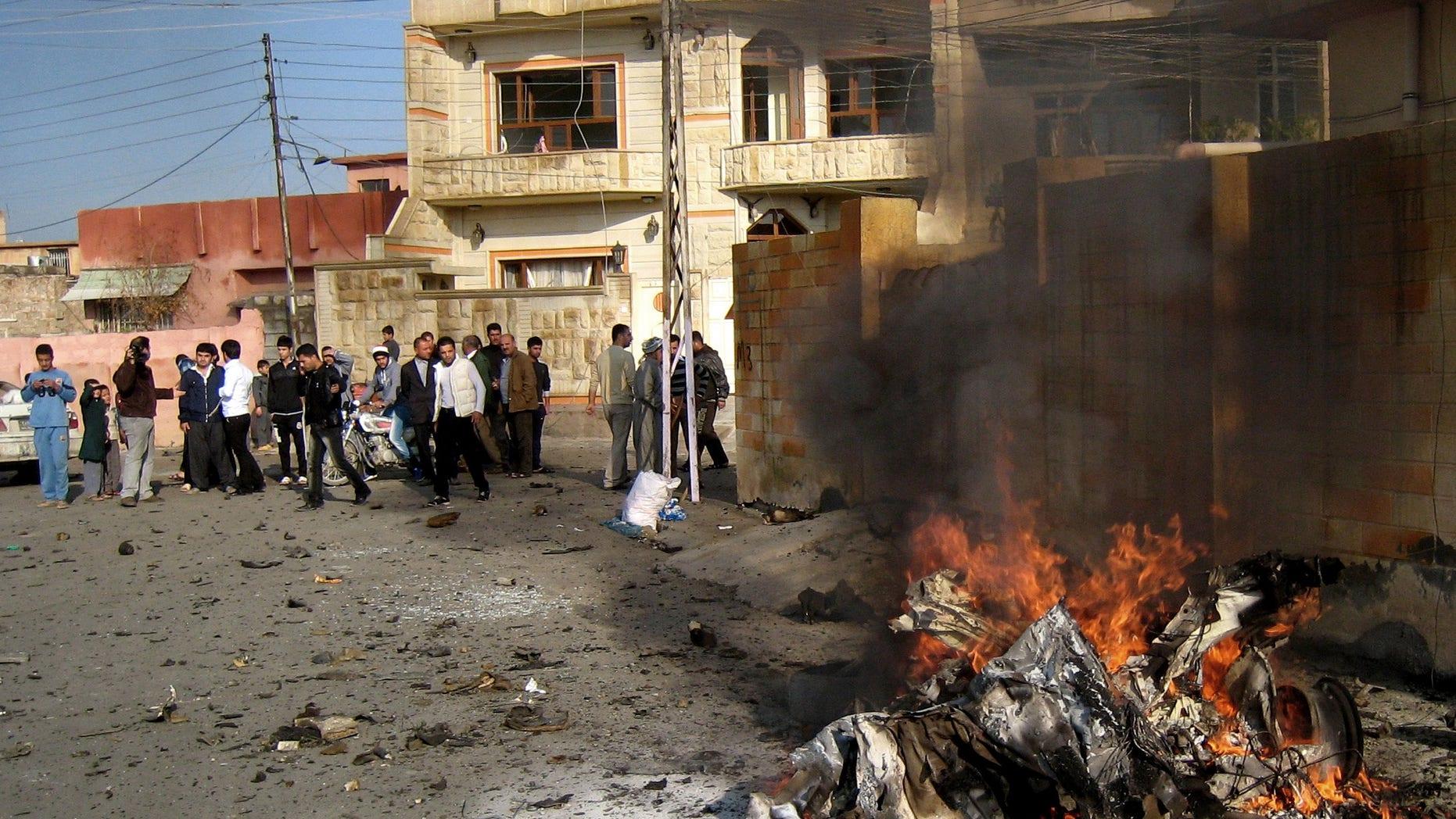 Nov. 27, 2012: Iraqis inspect the scene of a bomb attack in Kirkuk, 180 miles north of Baghdad, Iraq.