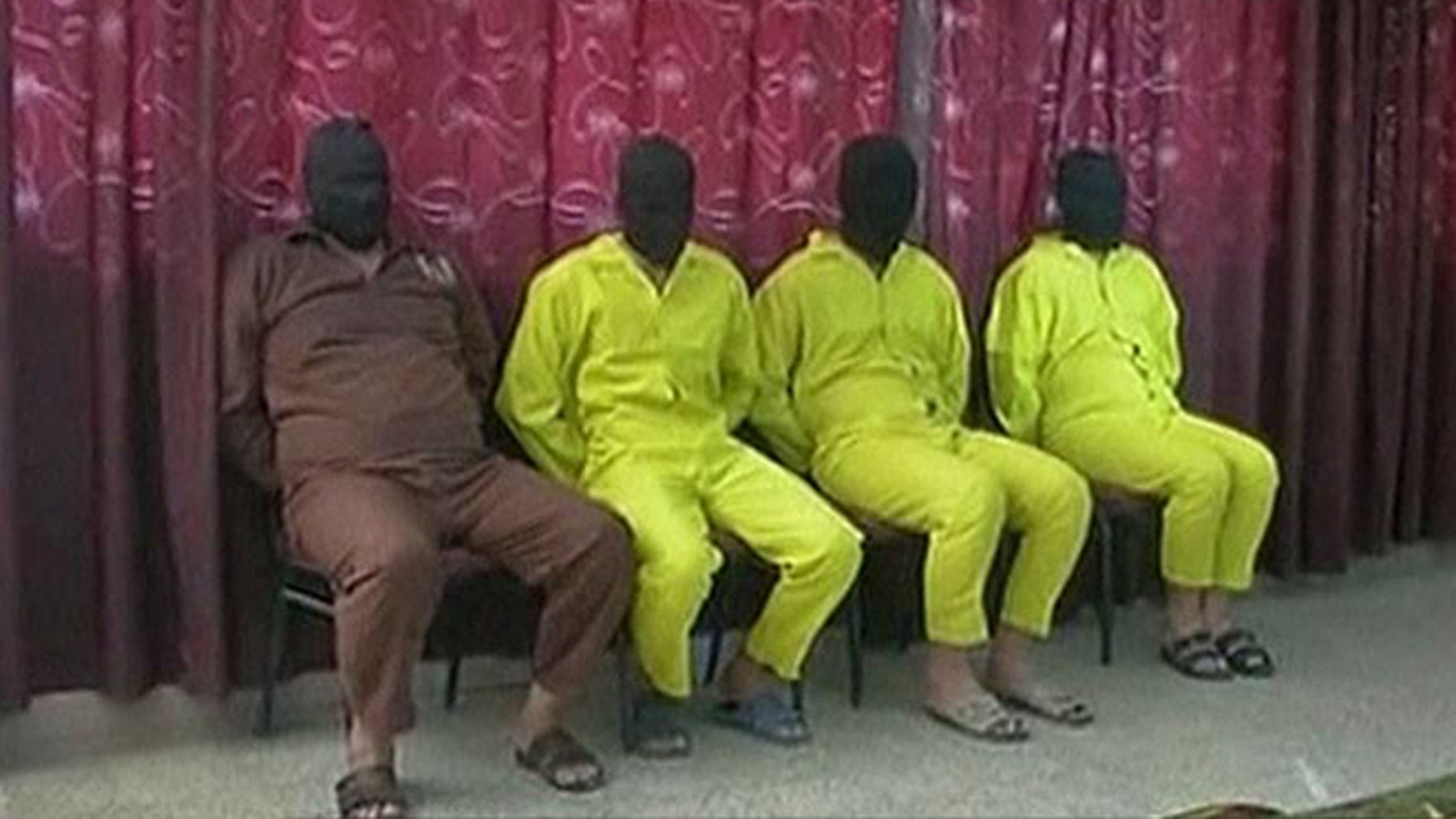 June 1, 2013: Four suspects believed to be involved in the chemical weapons plot are seen at a news conference in Iraq.