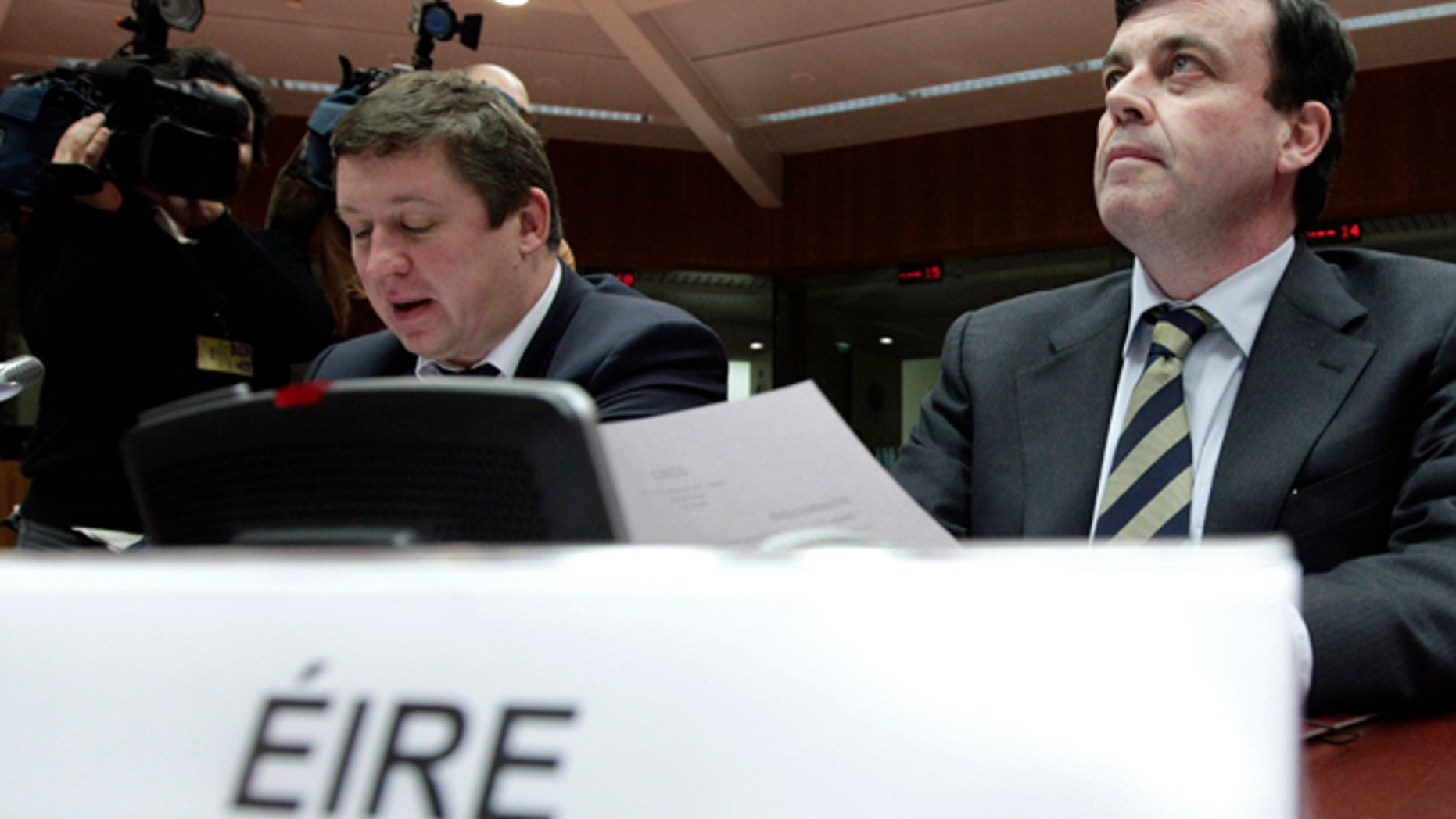 Nov. 28: Irish Finance Minister Brian Lenihan, right, waits for the start of a round table meeting of EU finance ministers at the EU Council building in Brussels. Finance ministers from the eurozone and the EU are met in Brussels Sunday to agree on a financial aid package for Ireland. (AP)