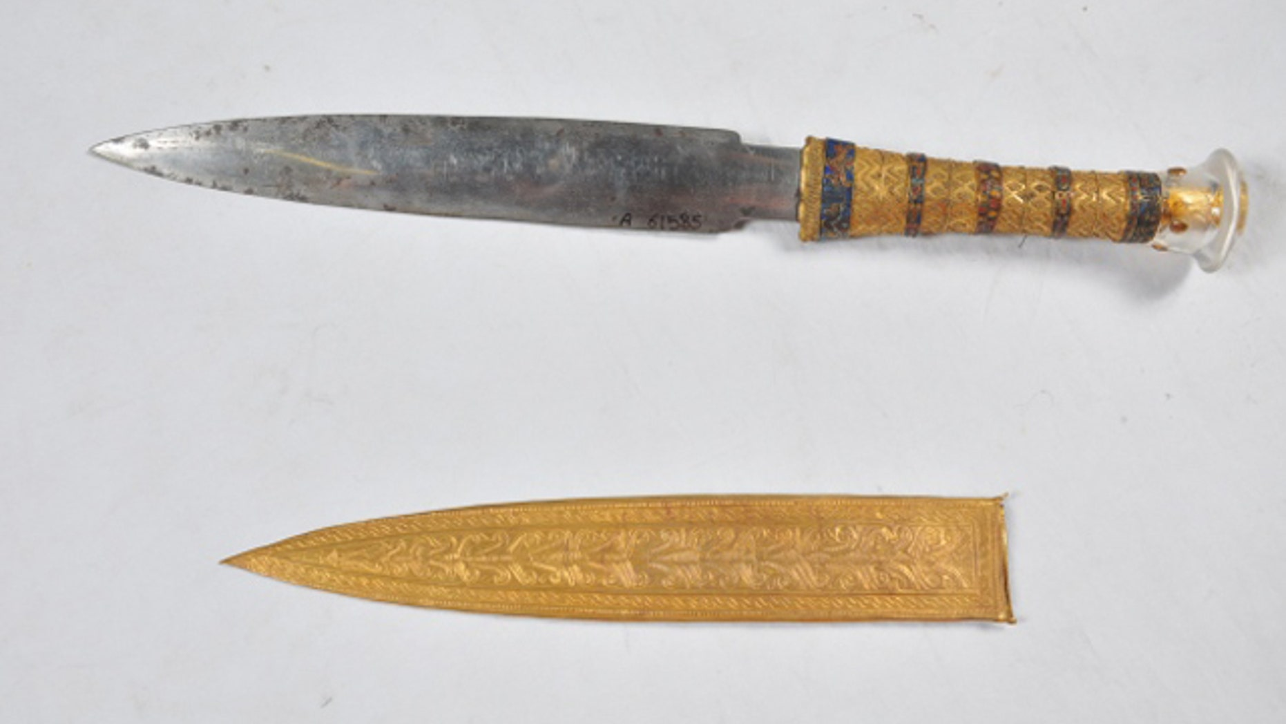 This undated image shows a dagger and sheath found in the tomb of the Egyptian pharaoh Tutankhamun