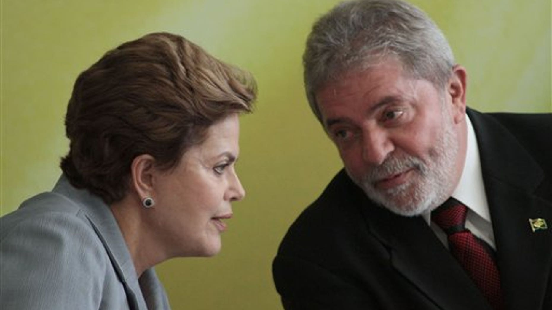 Brazil's President-elect Dilma Rousseff talks with President Luiz Inacio Lula da Silva during an event where Lula da Silva spoke of his eight-year administration at the presidential palace in Brasilia, Brazil, Wednesday Dec. 15, 2010. (AP Photo/Eraldo Peres)