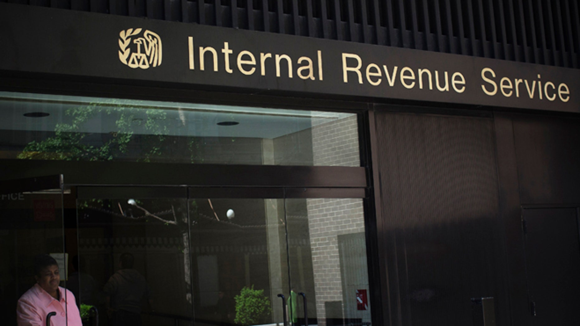 May 13, 2013: A woman walks out of the Internal Revenue Service building in New York.