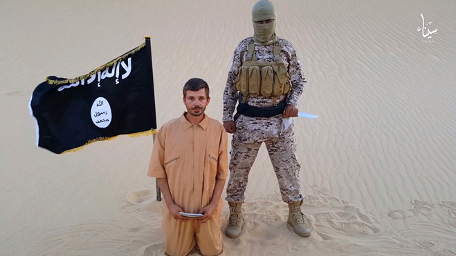 Aug. 5. 2015: This image made from a militant video posted on a social media website, which has been verified and is consistent with other AP reporting, purports to show a militant standing next to another man who identifies himself as 30-year-old Tomislav Salopek, kneeling down as he reads a message at an unknown location.