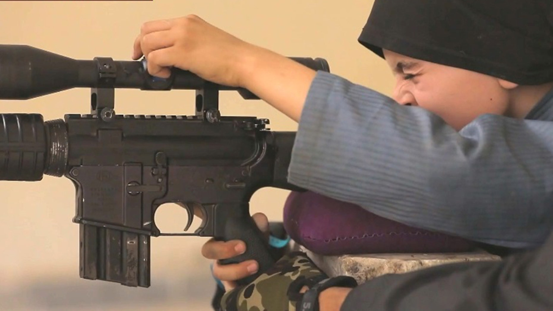 A boy claiming to be 10 years old and the son of American parents features in a new ISIS propaganda video.