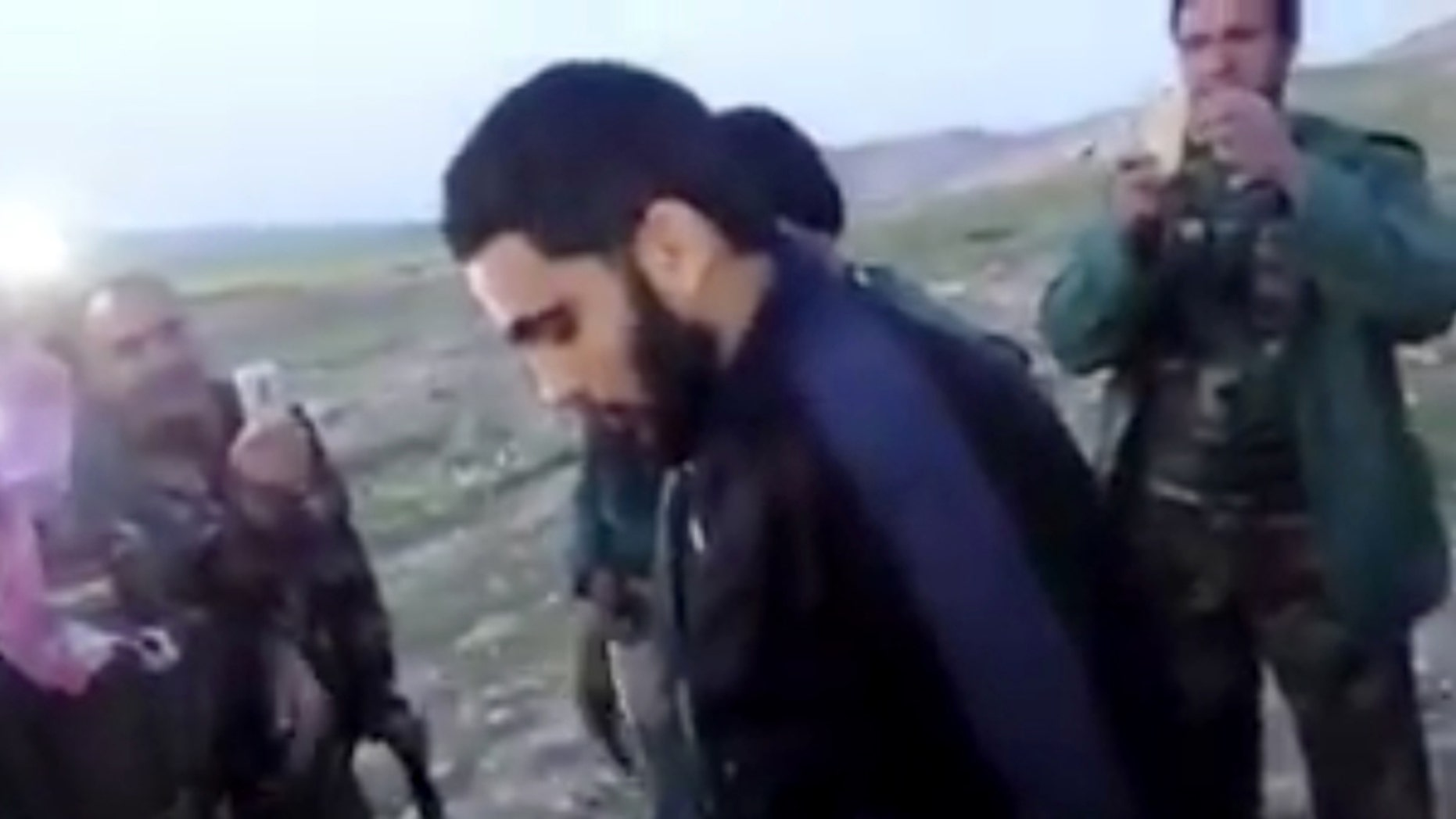 March 14, 2016: This image made from video posted on Twitter by a Kurdish fighter shows a man that the Kurdish military says is an American member of the Islamic State group shortly after he turned himself in to Kurdish fighters in northern Iraq.