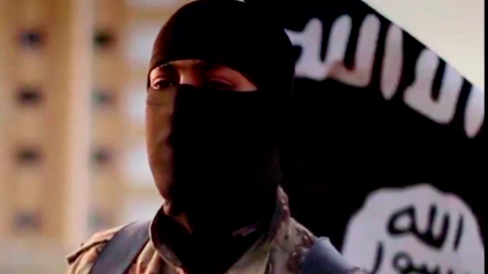 Oct. 8, 2014: A masked man speaking in what is believed to be a North American accent