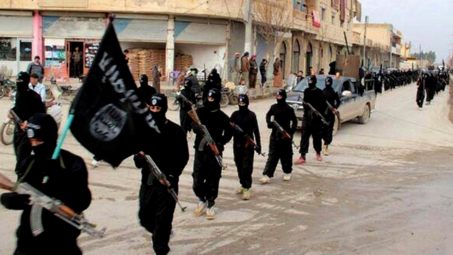 ISIS militants marching in Raqqa, Syria.