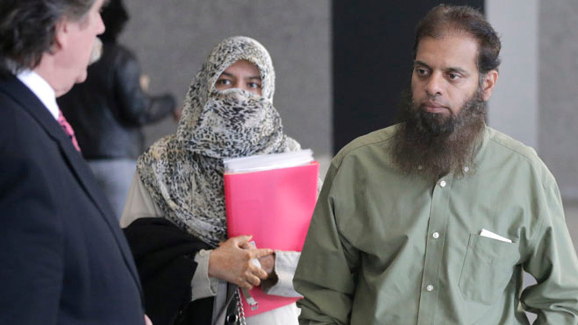 Oct. 9, 2014: Shafi Khan, right, and Zarine Khan, center, parents of Mohammed Hamzah Khan, meet with the family's attorney, Thomas Dirkin, left, before Khan's detention hearing in federal court in Chicago.