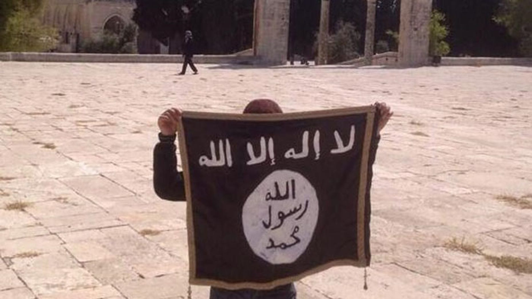 This Twitter photo of the Islamic State flag being held up at the Temple Mount, is one of several disturbing signs the terror group has support inside Israel.