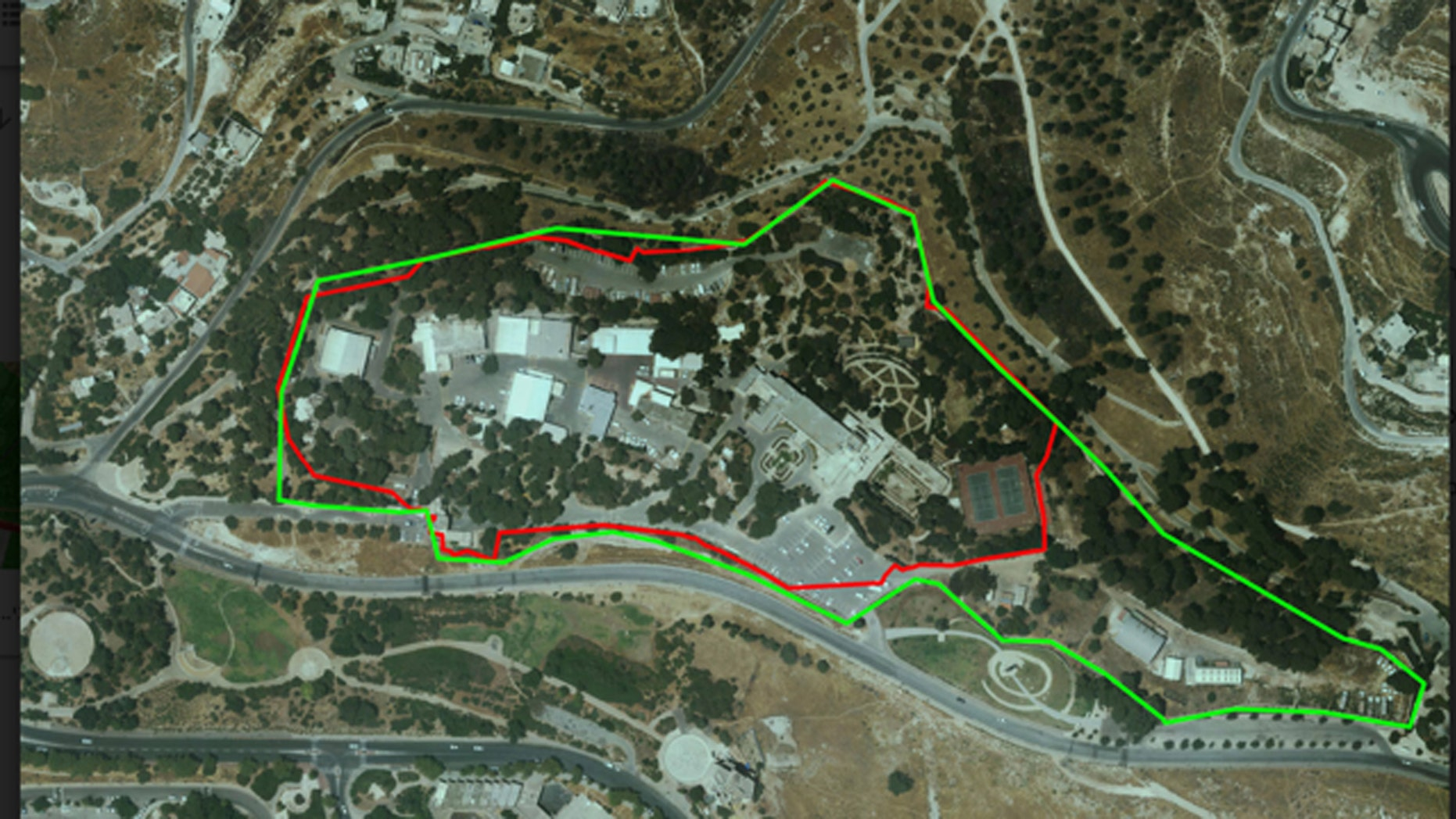An aerial view of the U.N. compound as it looks today. The green line is the current compound, the red line marks the original dimensions allotted by the Israeli government for use by the U.N. It has constructed additional buildings, a gas station, storage facilities, and more: all without building permits or oversight of any kind. (Regavim)