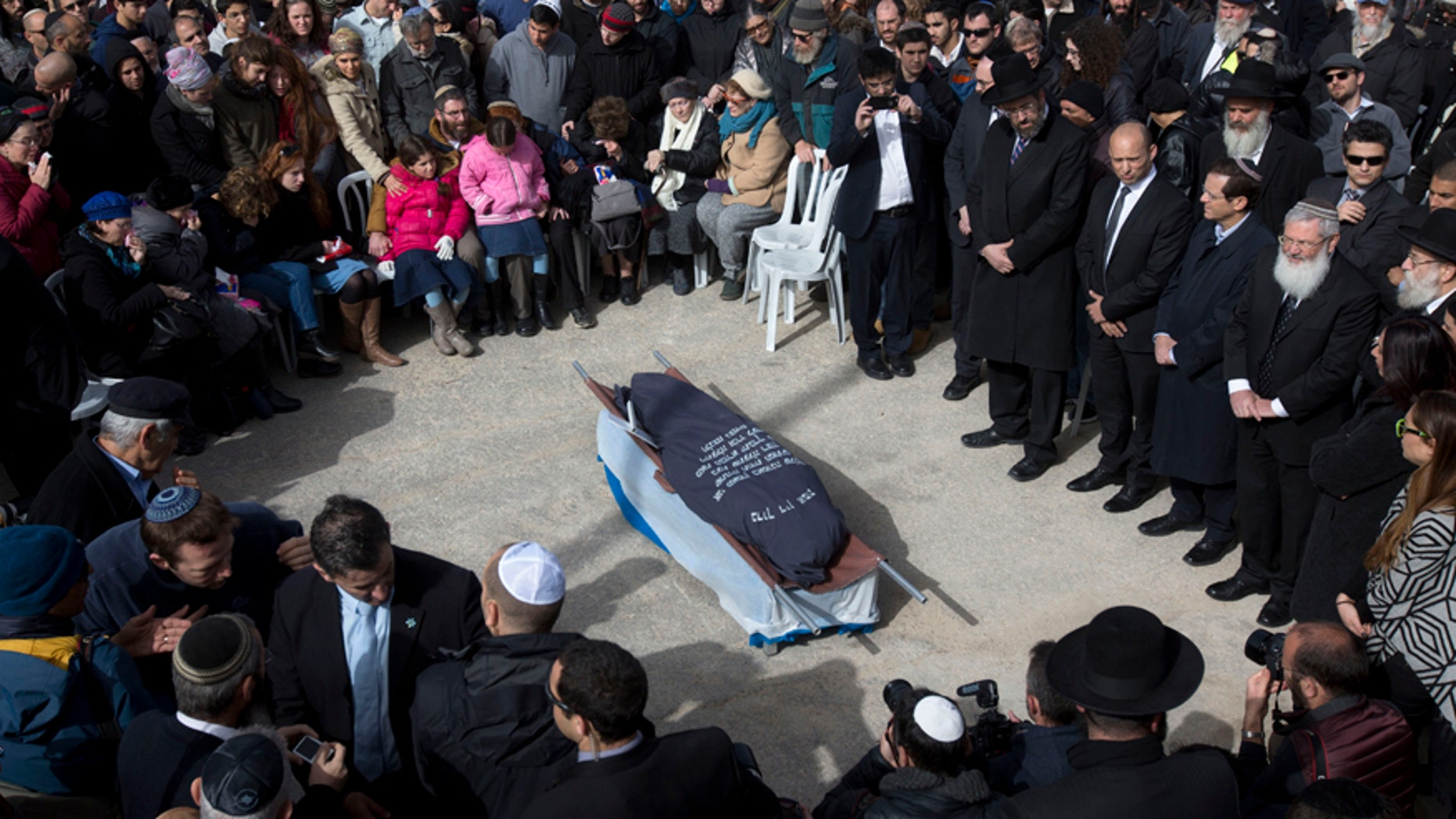 Jan. 18, 2016: Family and friends of Israeli Dafna Meir attend her funeral in a cemetery in Jerusalem.