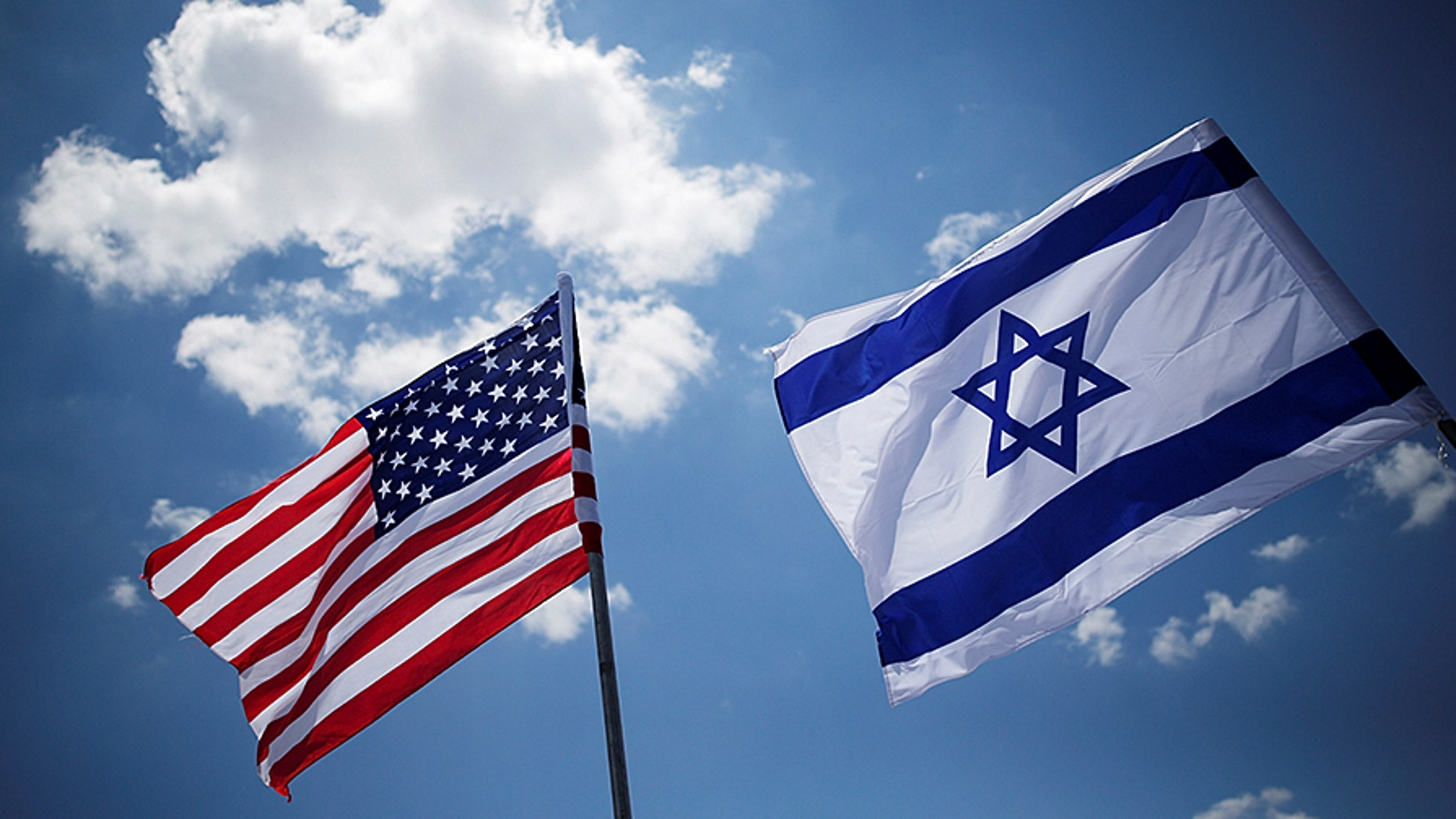 American and Israeli flags at Ben Gurion International Airport in Lod, Israel.