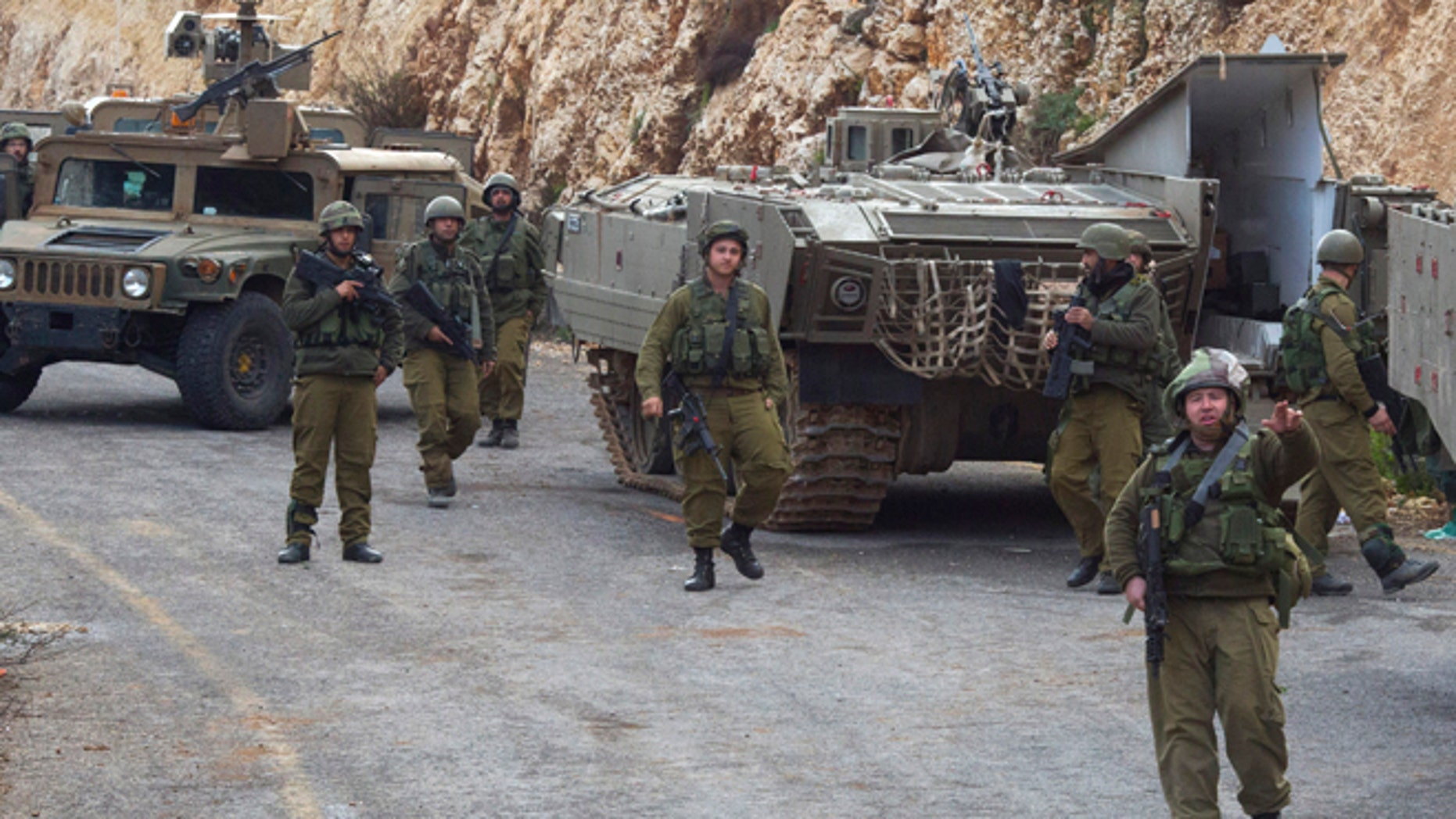 "Jan. 28, 2015: Israeli soldiers secure the Israel-Lebanon border. The Lebanese Hezbollah group is claiming responsibility for todays attack on an Israeli military convoy. Hezbollah claims the attack destroyed a number of Israeli vehicles and caused casualties among ""enemy ranks."" Israel later fired at least 35 artillery shells into Lebanon."