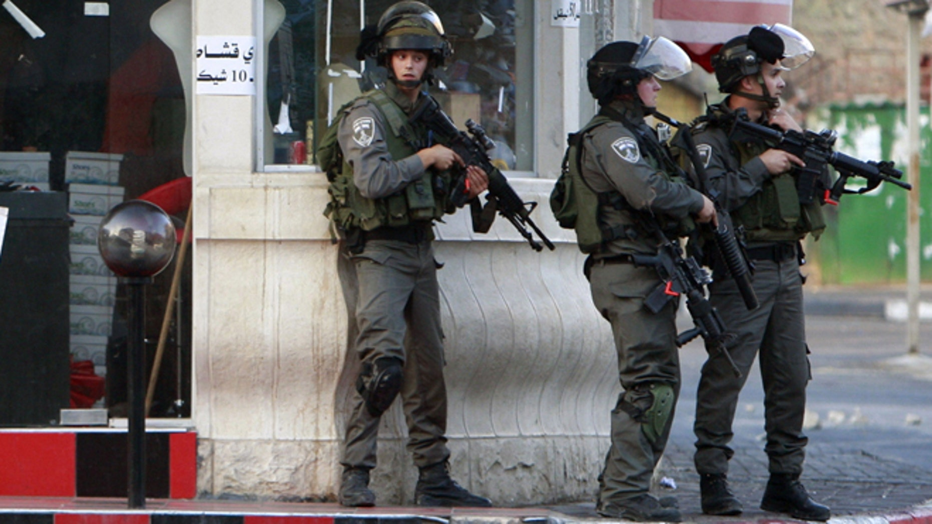 June 19, 2014: Israeli soldiers search for three missing Israeli teens believed to have been abducted in the West Bank city of Jenin. Since the operation to locate the teens began a week ago, about 280 Palestinians have been arrested, the military said, including 200 members of Hamas.