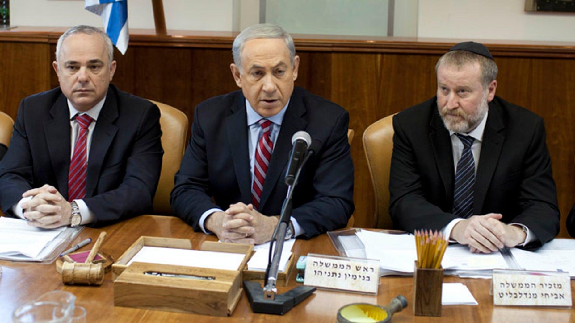 Nov. 24, 2013: Israeli Prime Minister Benjamin Netanyahu, center, attends the weekly cabinet meeting at his office in Jerusalem, Israel.