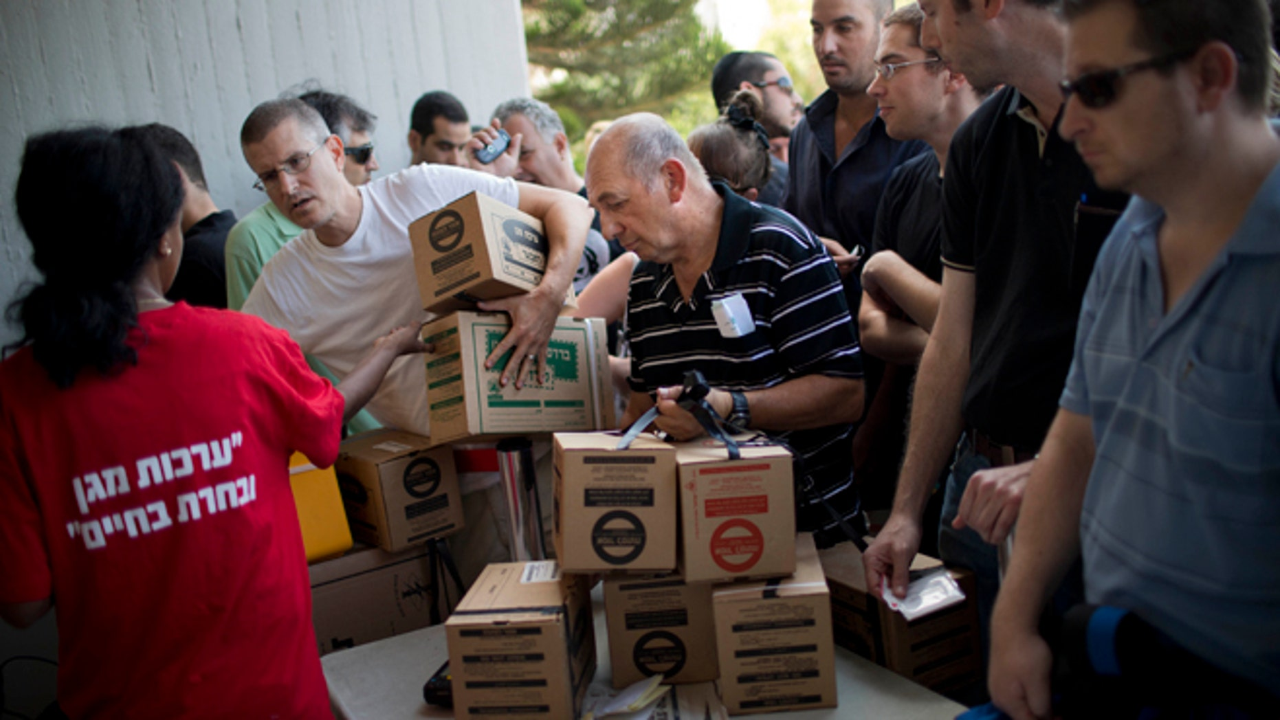 Aug. 28, 2013: Israelis line up at a gas mask distribution center in Tel Aviv, Israel. Large crowds of Israelis have lined up at gas-mask distribution centers across the country in anticipation of a possible Syrian attack on Israel.