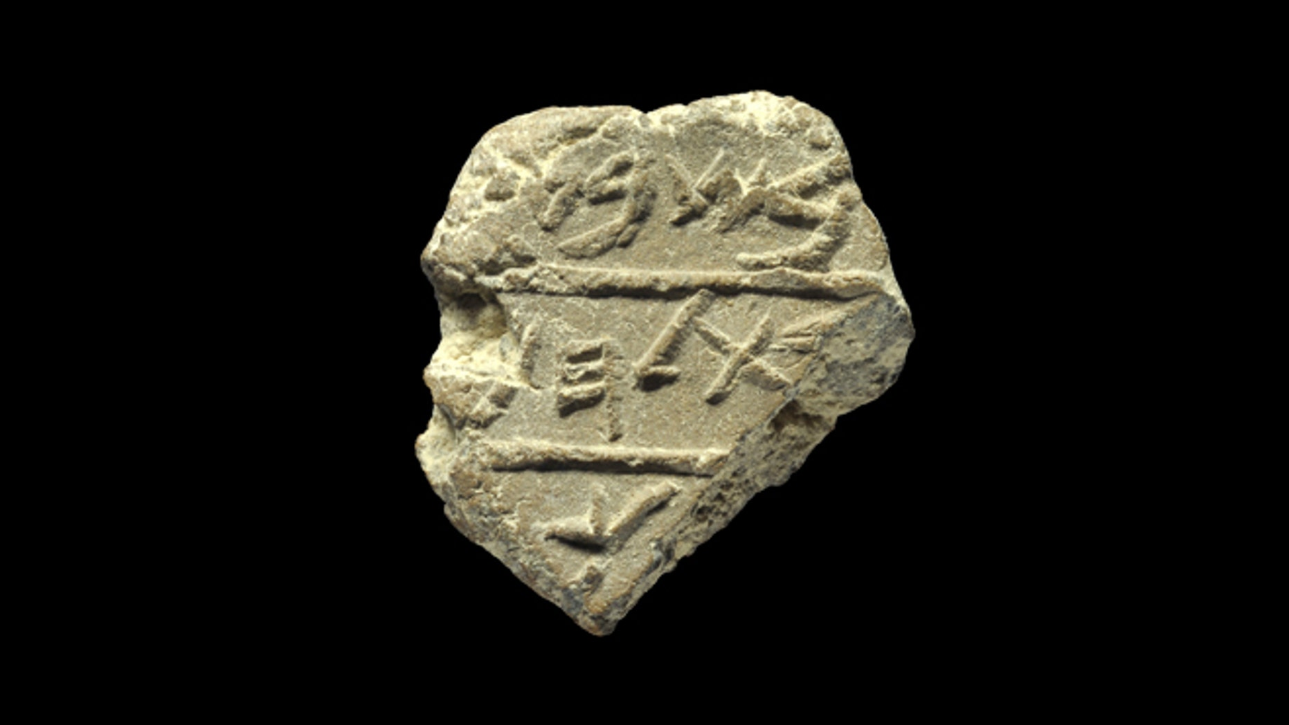 "In this photo made available, Wednesday, May 22, 2012 by Israel's Antiquities Authority, shows a detail of a seal bearing the name ""Bethlehem"" in ancient Hebrew script."