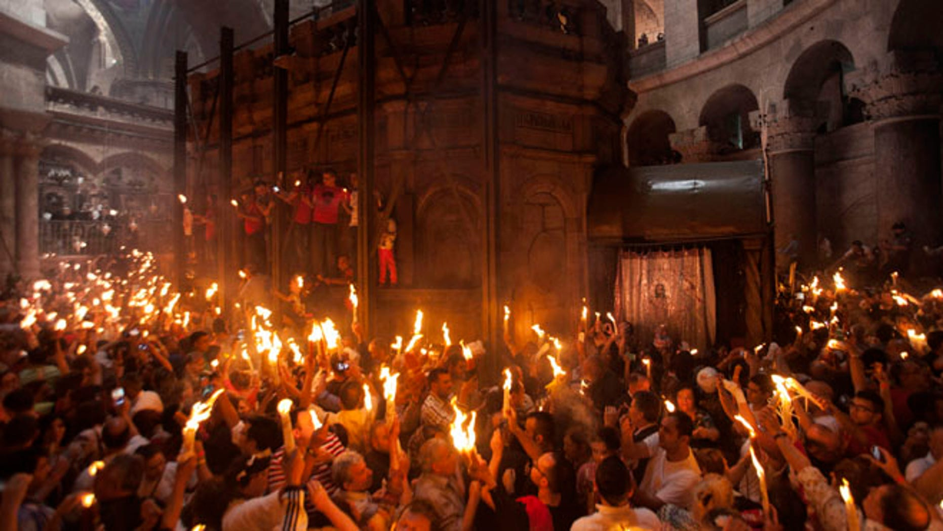 Apr. 19, 2014: Christian pilgrims hold candles at the church of the Holy Sepulcher, traditionally believed to be the burial site of Jesus Christ, during the ceremony of the Holy Fire in Jerusalem's Old City.