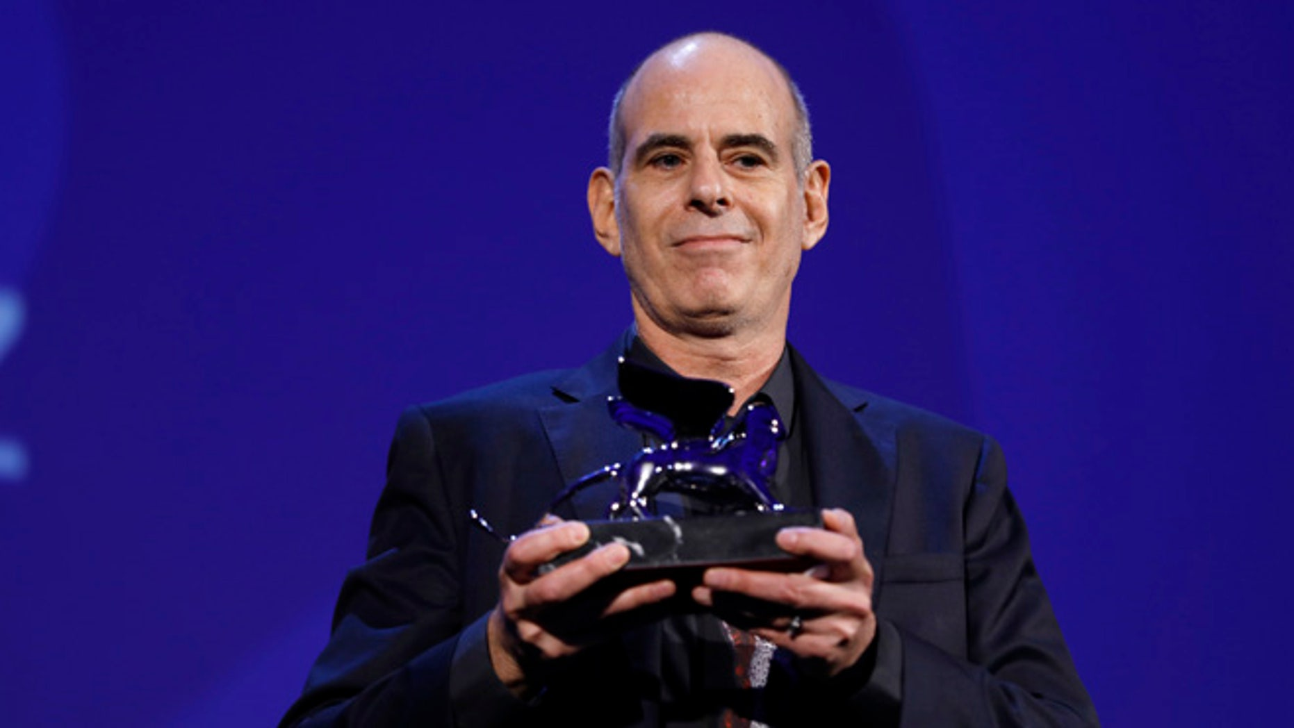 """Samuel Moaz is awarded the jury's special Silver Lion prize for """"Foxtrot"""" at the 74th Venice Film Festival."""