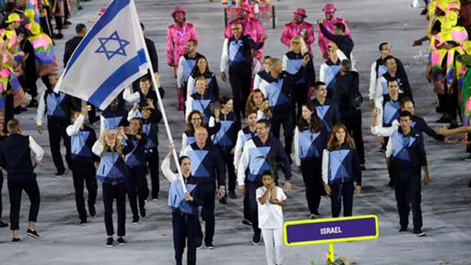 Neta Rivkin carries the flag of Israel during the opening ceremony for the 2016 Summer Olympics in Rio de Janeiro, Brazil, Friday, Aug. 5.