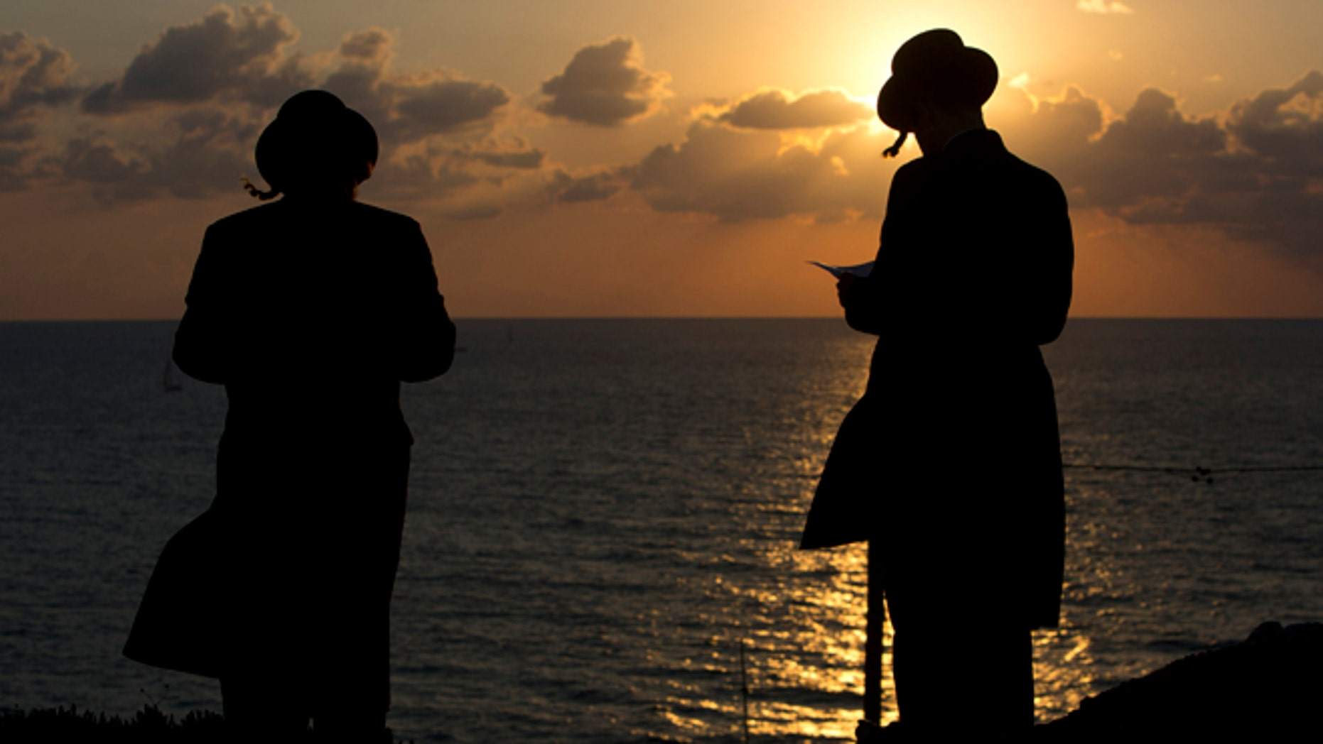 Oct. 2, 2014: Ultra-Orthodox Jews of the Hassidic sect Vizhnitz gather on a hill overlooking the Mediterranean sea as they participate in a Tashlich ceremony in Herzeliya, Israel. (AP)