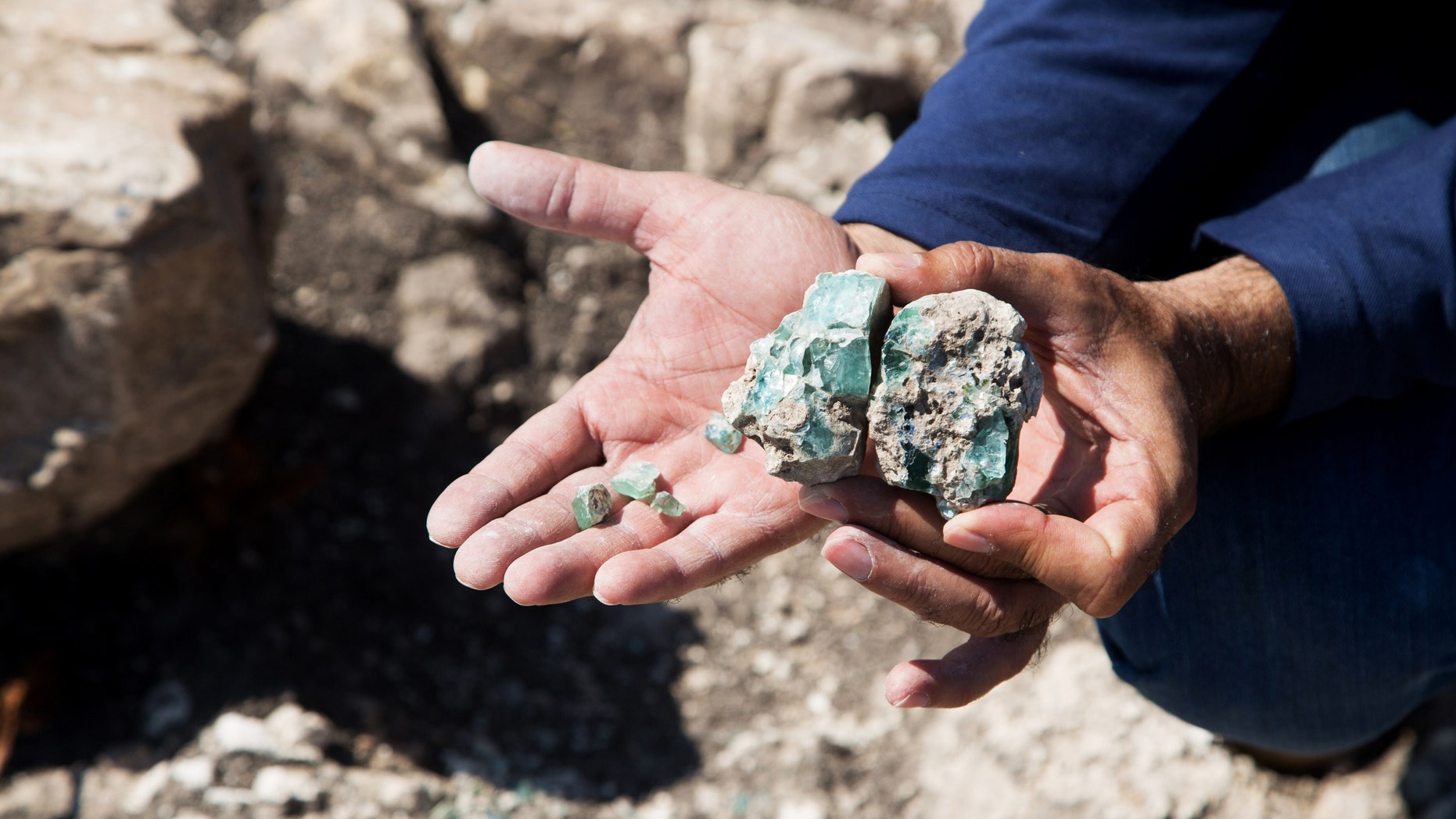 Small fragments of the raw glass as they were found at the site.(Photo: Assaf Peretz, courtesy of Israel Antiquities Authority)