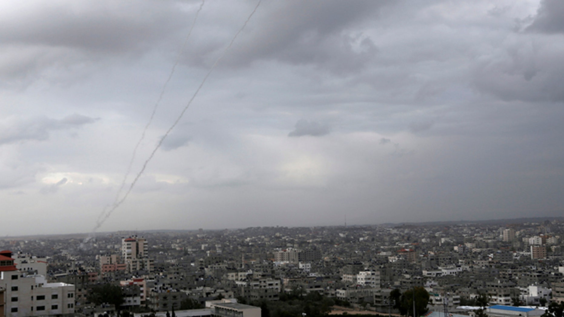 Mar. 12, 2014: A trail of smoke from rockets fired by Palestinian militants from Gaza toward Israel is seen above Gaza City.