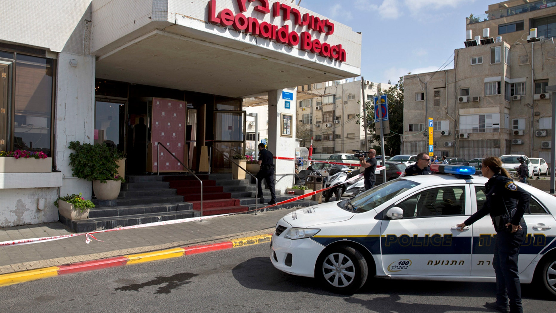Israeli police officers stand guard at the scene of a stabbing attack in Tel Aviv, Israel. Sunday, April 23, 2017.