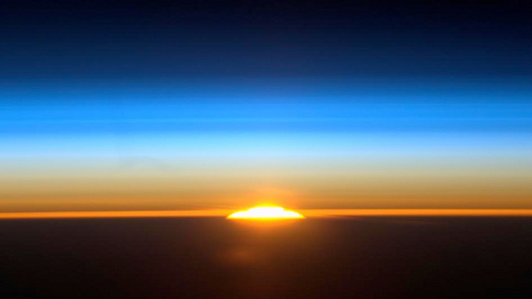 Nickel-eating bacteria may have worsened the mass die-off some 250 million years ago, scientists suggest. (Shown here, International Space Station astronaut Ron Garan captures one of the 16 sunrises they see each day, on Aug. 27, 2011.)
