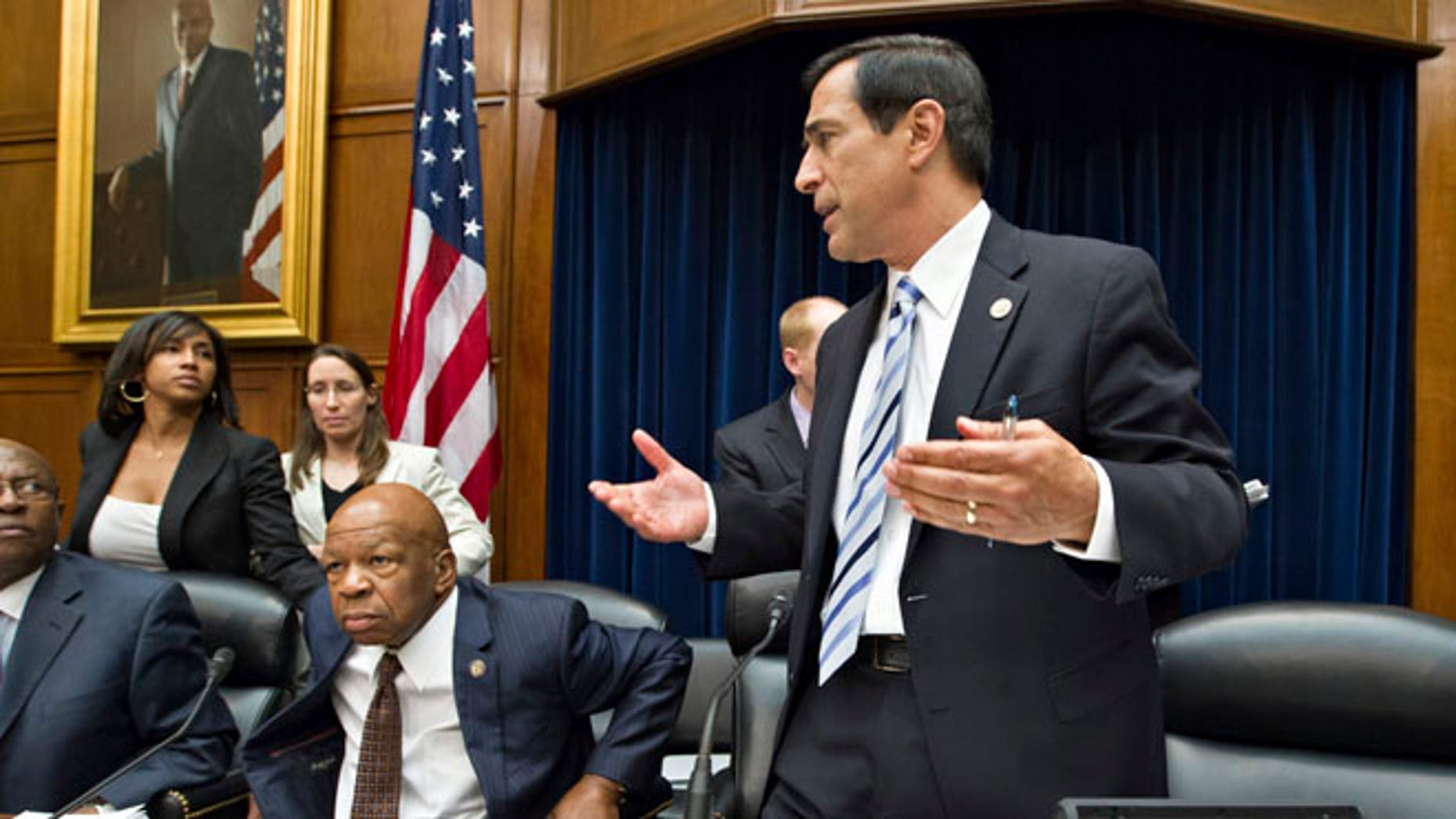 FILE: June 20, 2012: Rep. Darrell Issa, R-Calif., right, adjourns a meeting of the House Oversight and Government Reform Committee, in Washington, D.C.