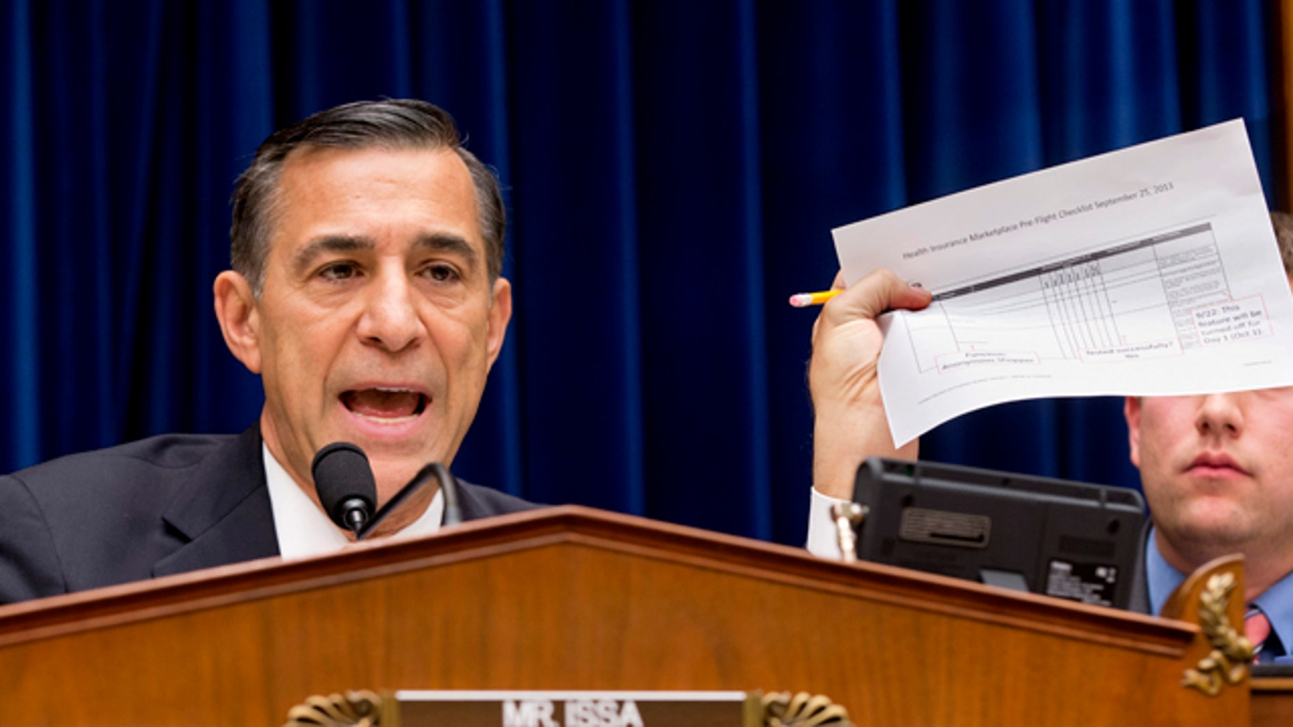 Nov. 13, 2013: House Oversight Committee Chairman Rep. Darrell Issa, R-Calif., holds up a checklist related to the preparation for the implementation of the ObamaCare healthcare program, and specifically, the HealthCare.gov website, on Capitol Hill in Washington.