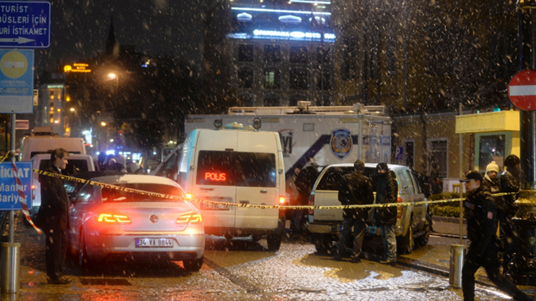Jan. 6: Turkish security gather outside a police station where one police officer was killed and another injured after a suicide bomber blew herself up in Istanbul.