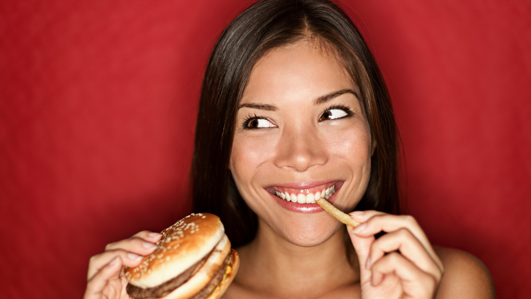 A high school senior decided to use McDonald's at the backdrop for her senior photos.