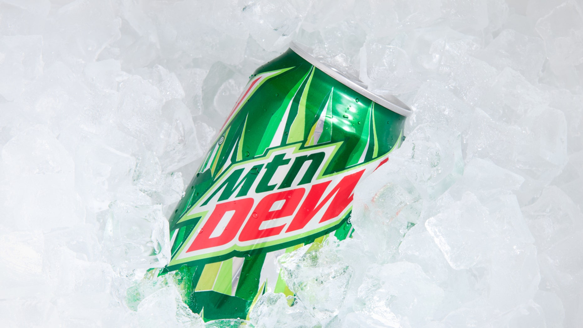 """""""Orlando, USA - November 8, 2011: A can of Mountain Dew buried in ice cubes. Focus on the can. Mountain Dew is a soft drink produced by Pepsi-Co . It contains caffeine. The drink was introduced in the 1960s."""""""